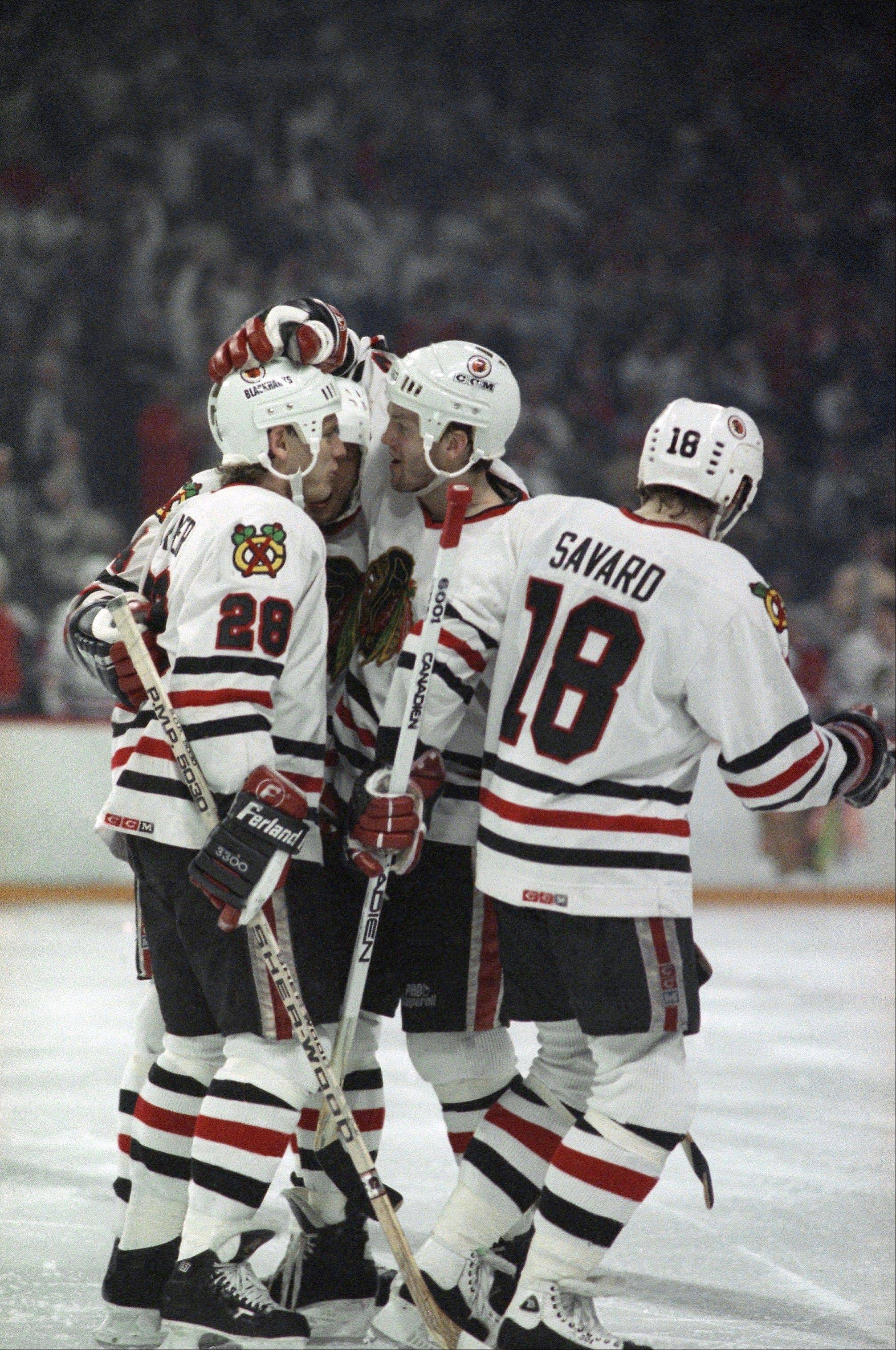 Steve Konroyd, center, and Denis Savard (18) have some amazing memories from the NHL playoffs, which they shared with Blackhawks Team Historian Bob Verdi. Now both are serving a commentators during the Blackhawks' run of five straight overtime games.
