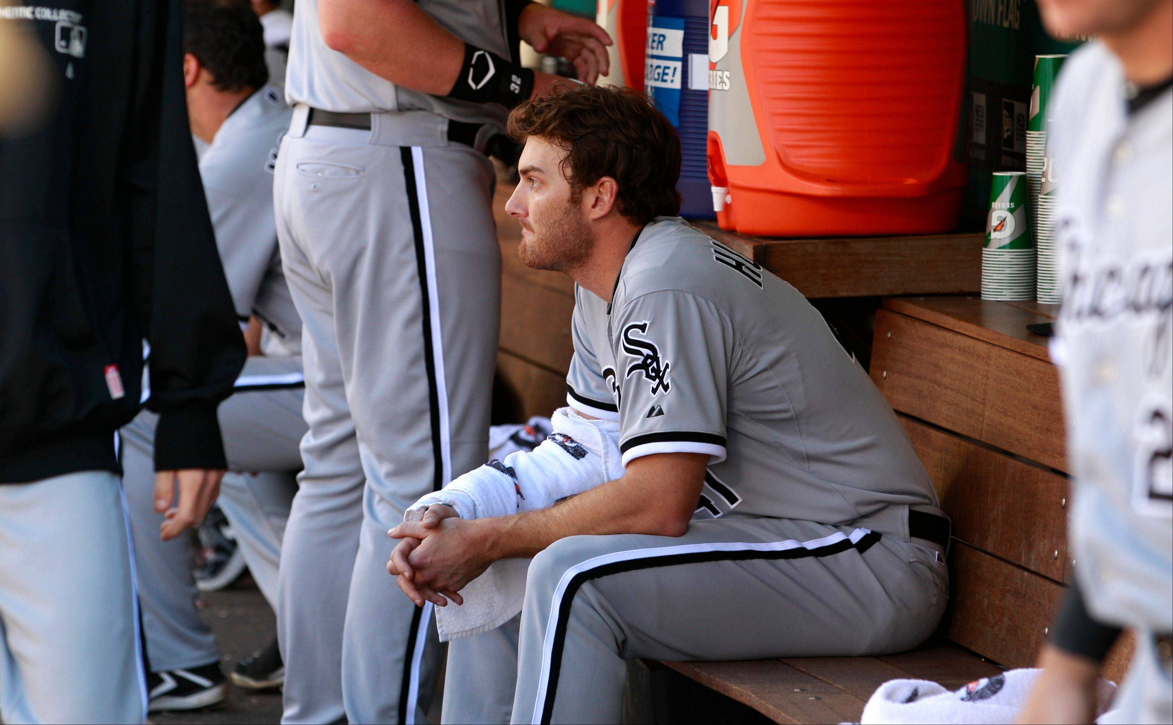 White Sox starting pitcher Phil Humber sits alone in the dugout Saturday before heading out for the ninth inning.
