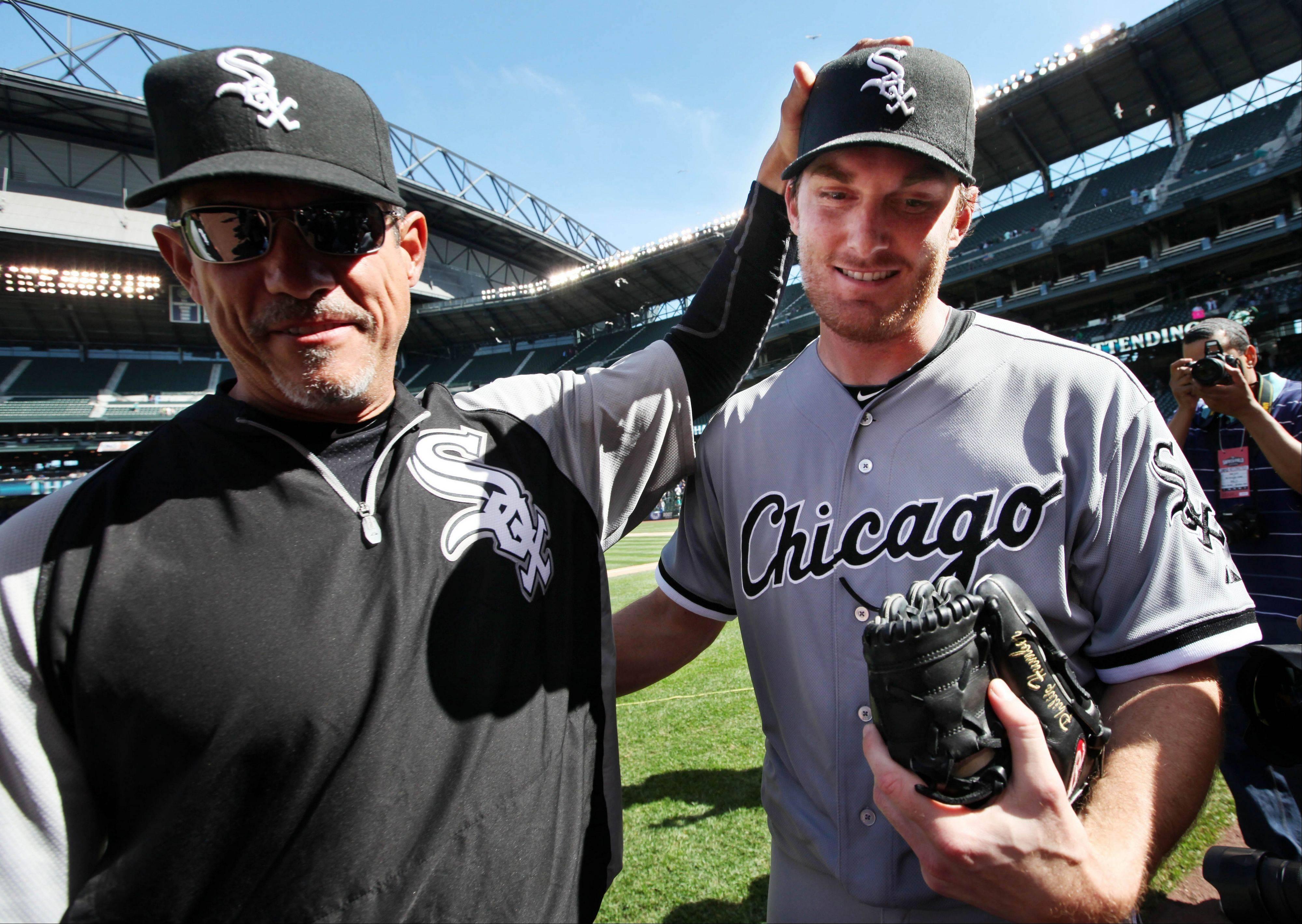 White Sox starting pitcher Phil Humber, right, is congratulated Saturday after pitching a perfect game.