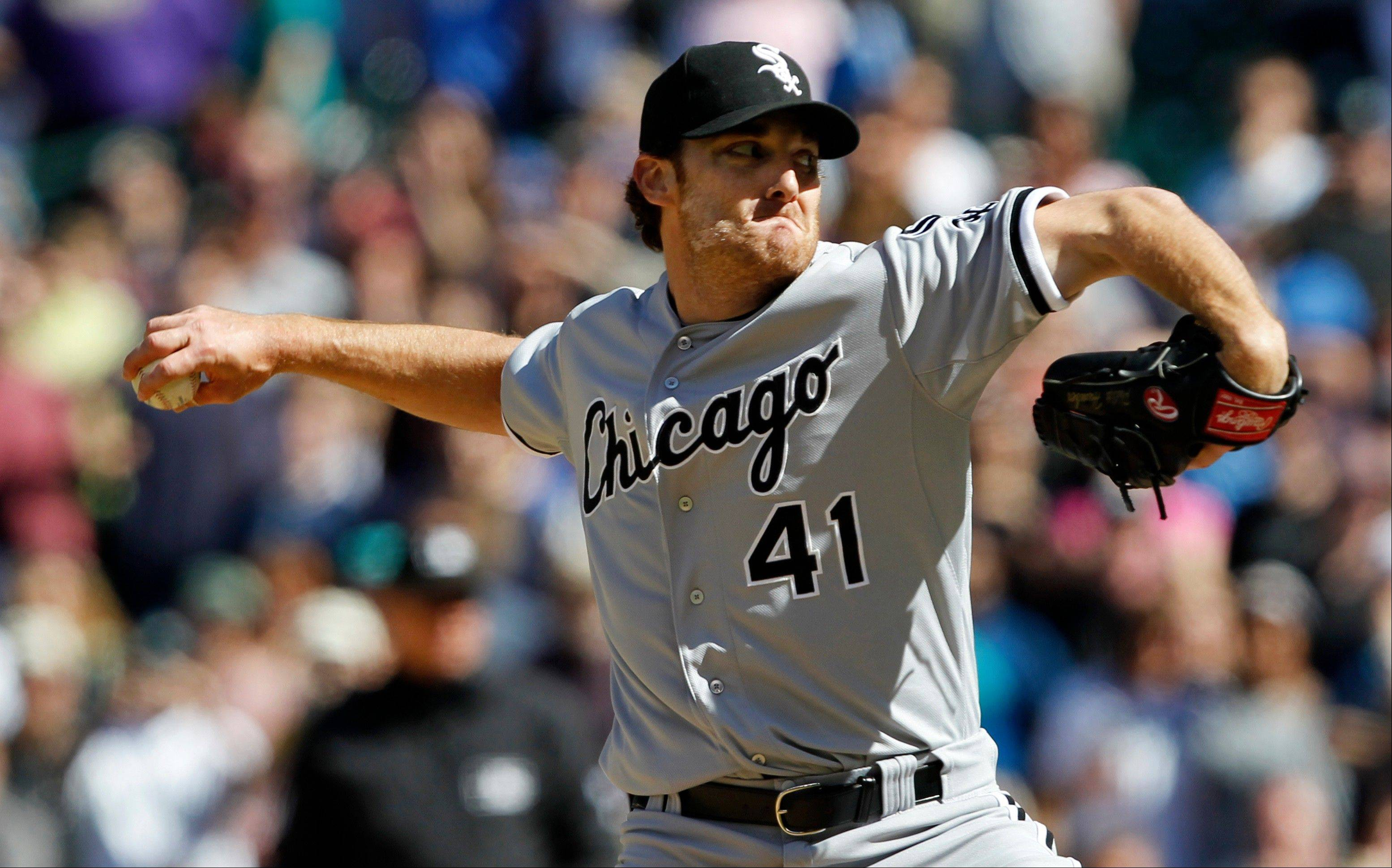 White Sox starting pitcher Phil Humber throws to the final batter while pitching a perfect game Saturday against the Seattle Mariners in Seattle.