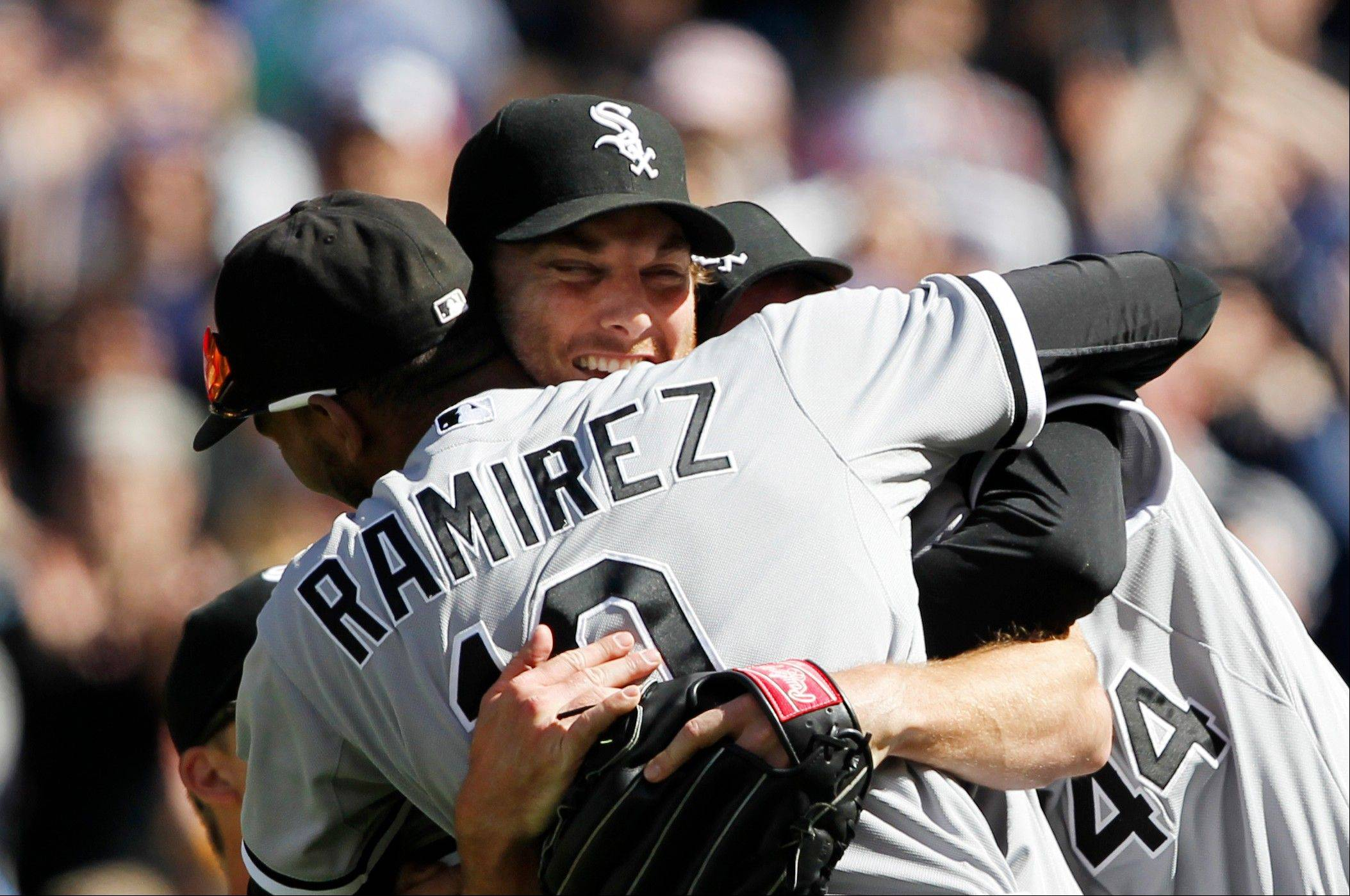 White Sox starting pitcher Phil Humber, center, is mobbed by teammates Saturday after pitching a perfect game.