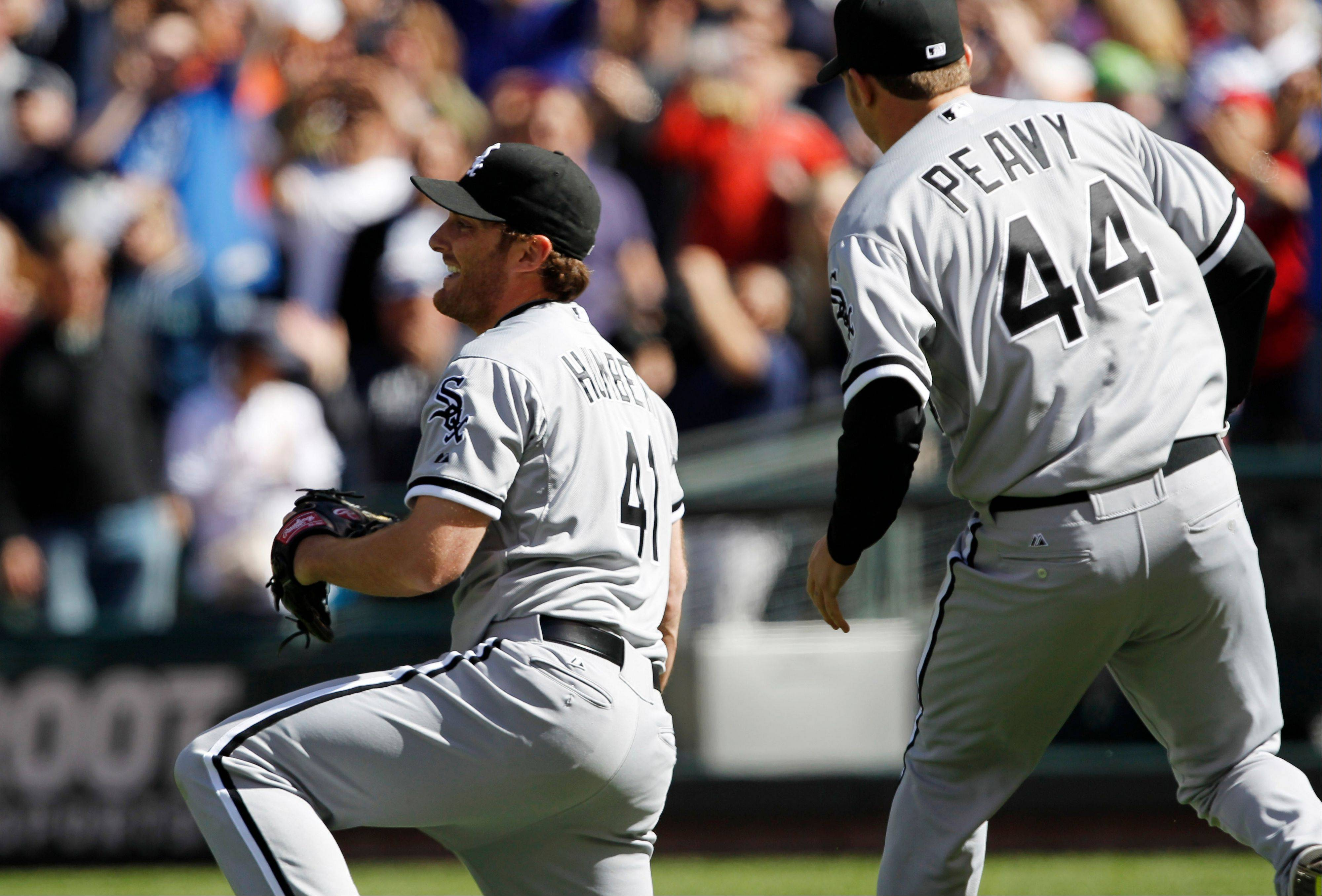 White Sox starting pitcher Philip Humber, left, reacts Saturday after pitching a perfect game.