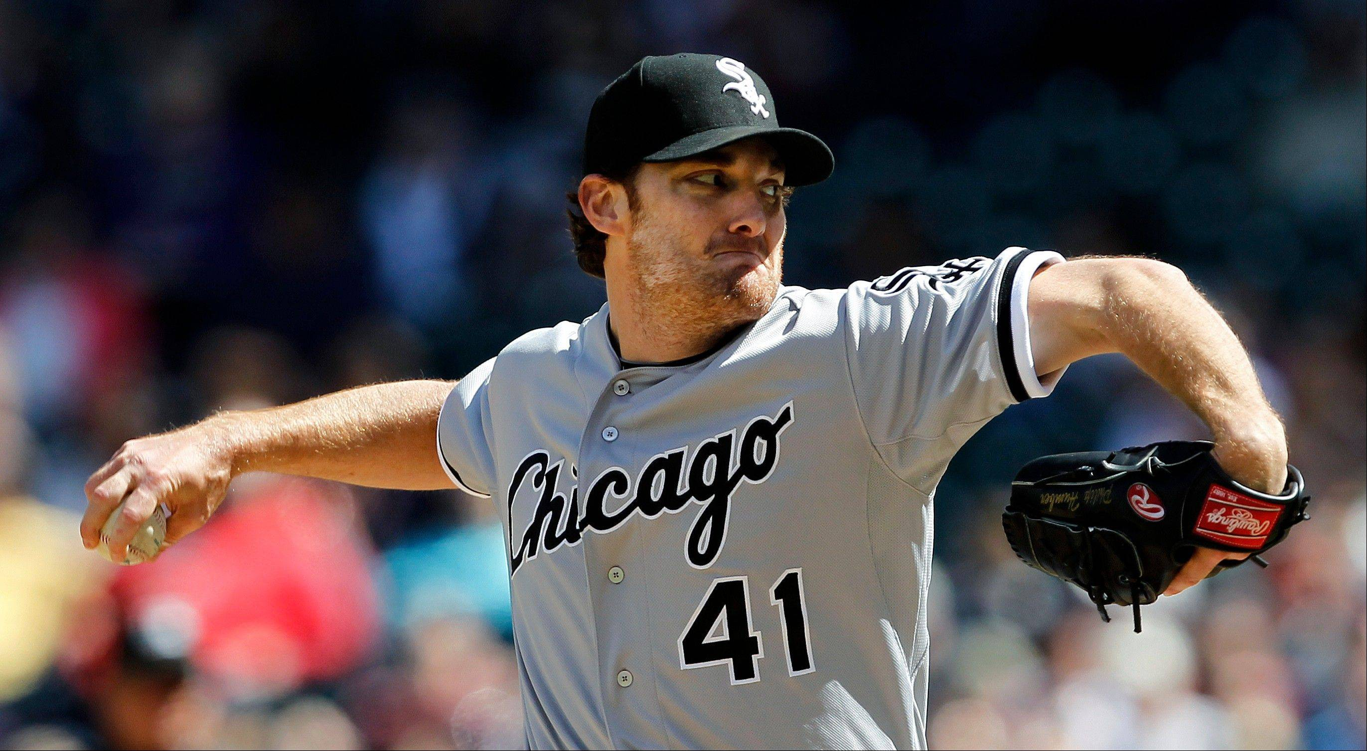 White Sox starting pitcher Phil Humber throws against the Seattle Mariners in the third inning.