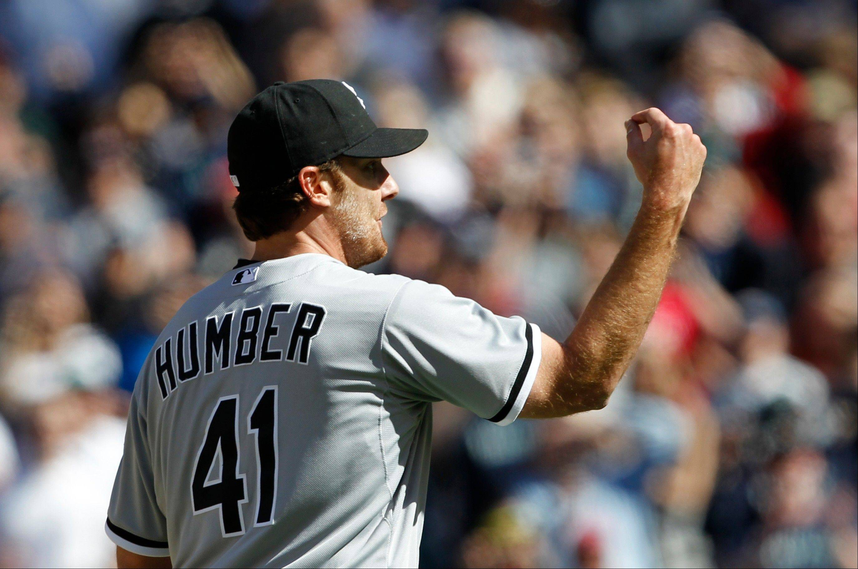 White Sox starting pitcher Phil Humber signals to the plate for a strike after his final pitch in his perfect game Saturday against the Seattle Mariners in Seattle. The White Sox won 4-0.