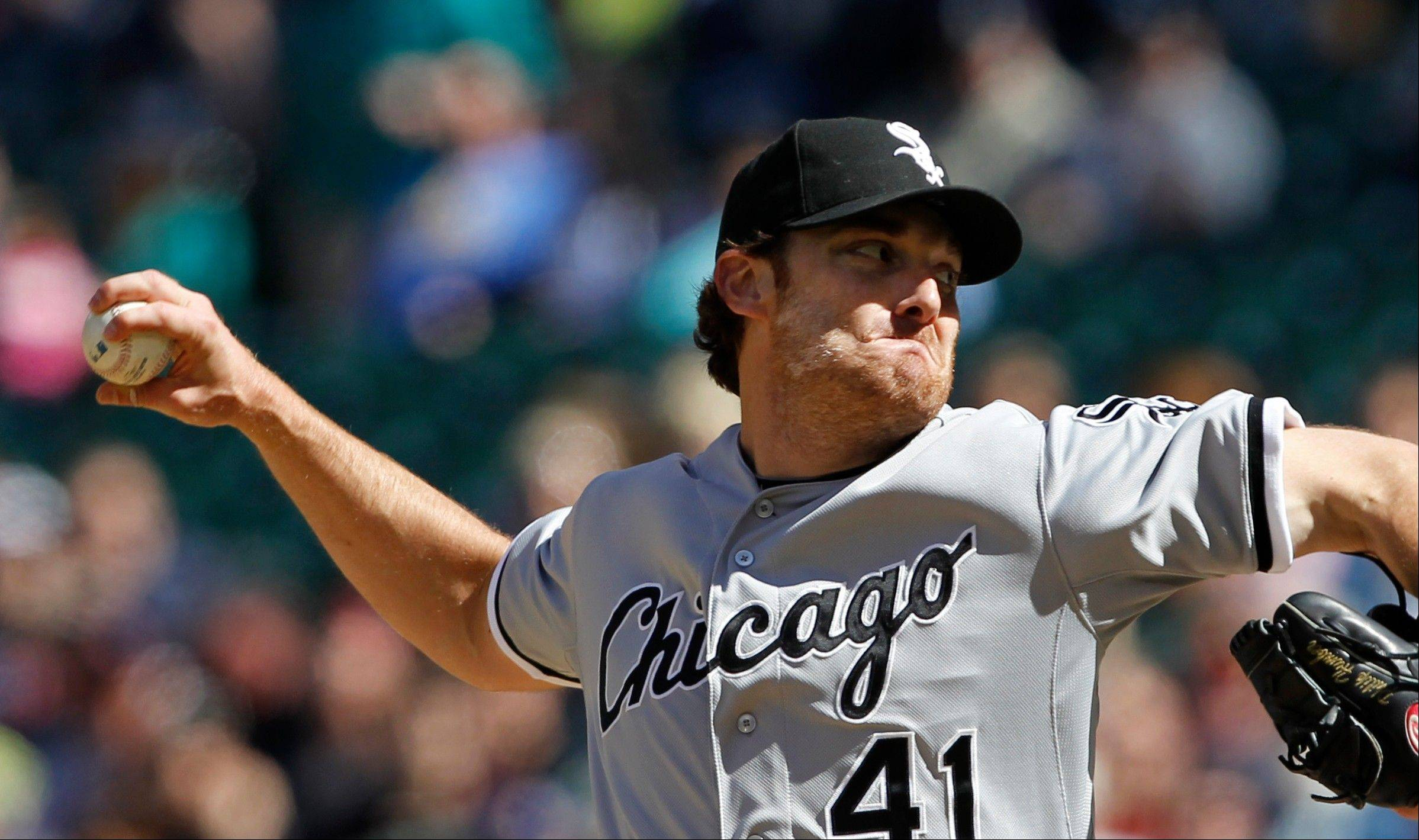 White Sox starter Philip Humber throws in the ninth inning Saturday against the Seattle Mariners in Seattle.
