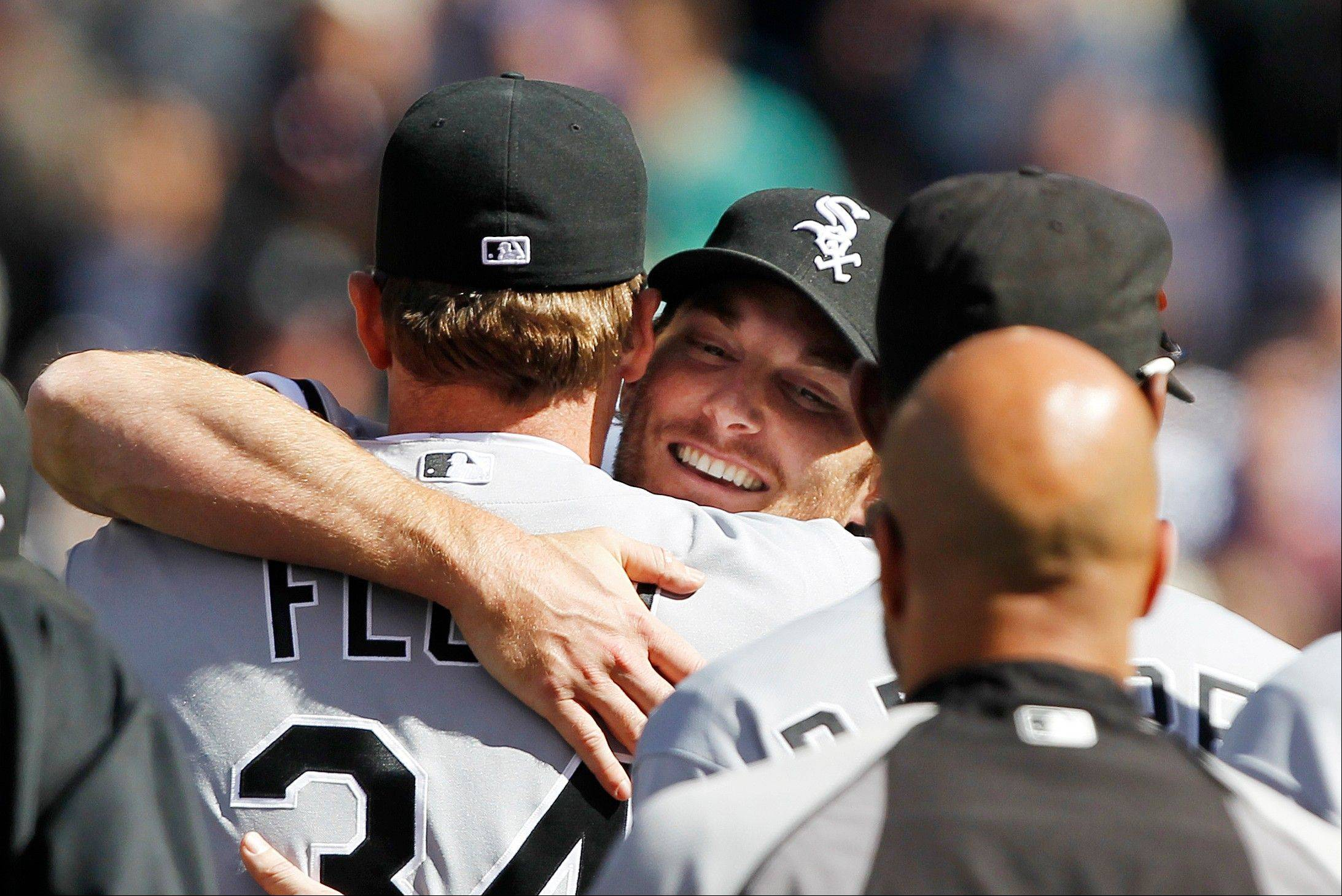 White Sox starting pitcher Philip Humber, center, is mobbed by teammates Saturday after pitching a perfect game against the Seattle Mariners in Seattle. The White Sox won 4-0.