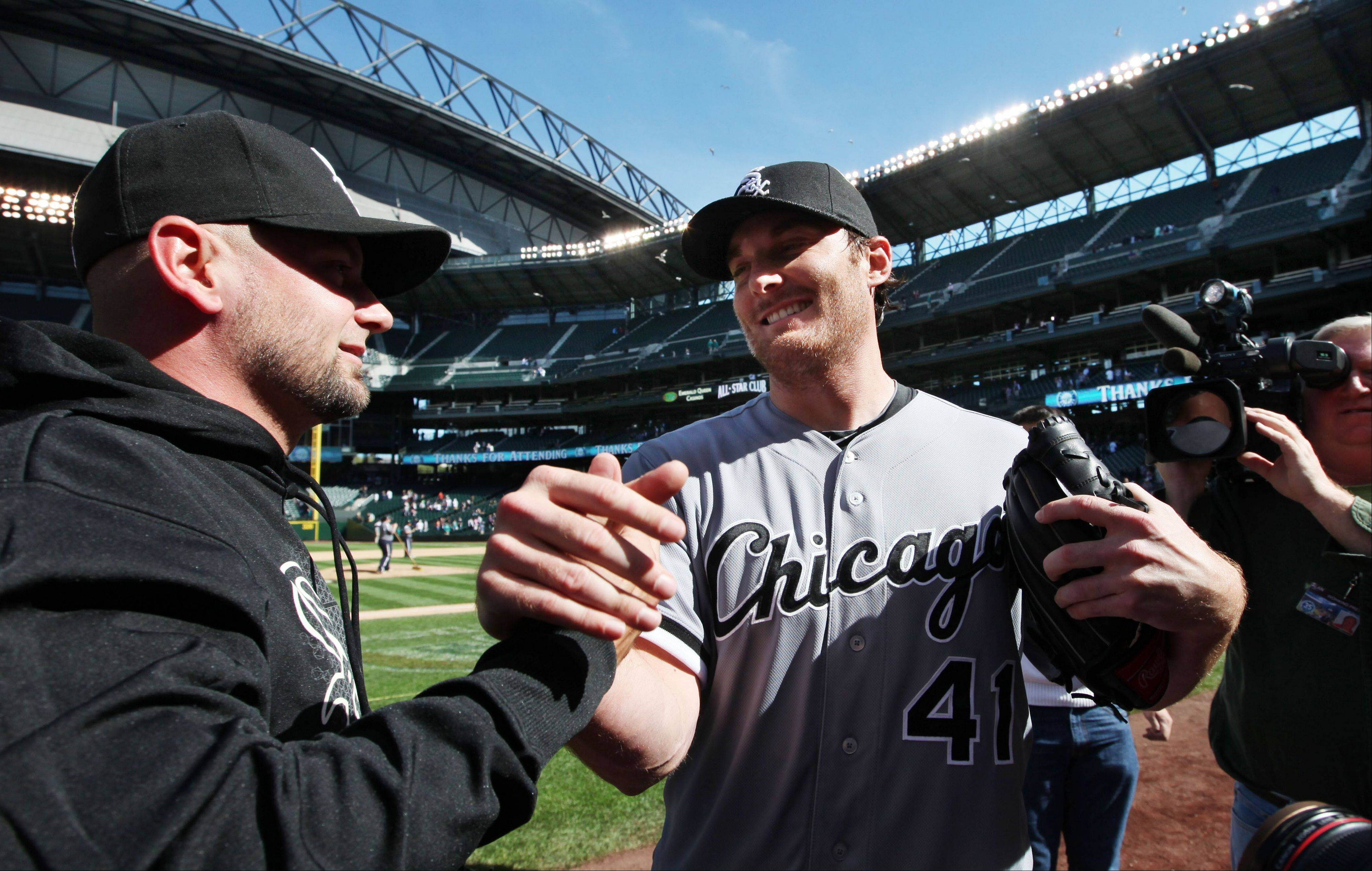 White Sox starting pitcher Phil Humber is congratulated Saturday after pitching a perfect game.