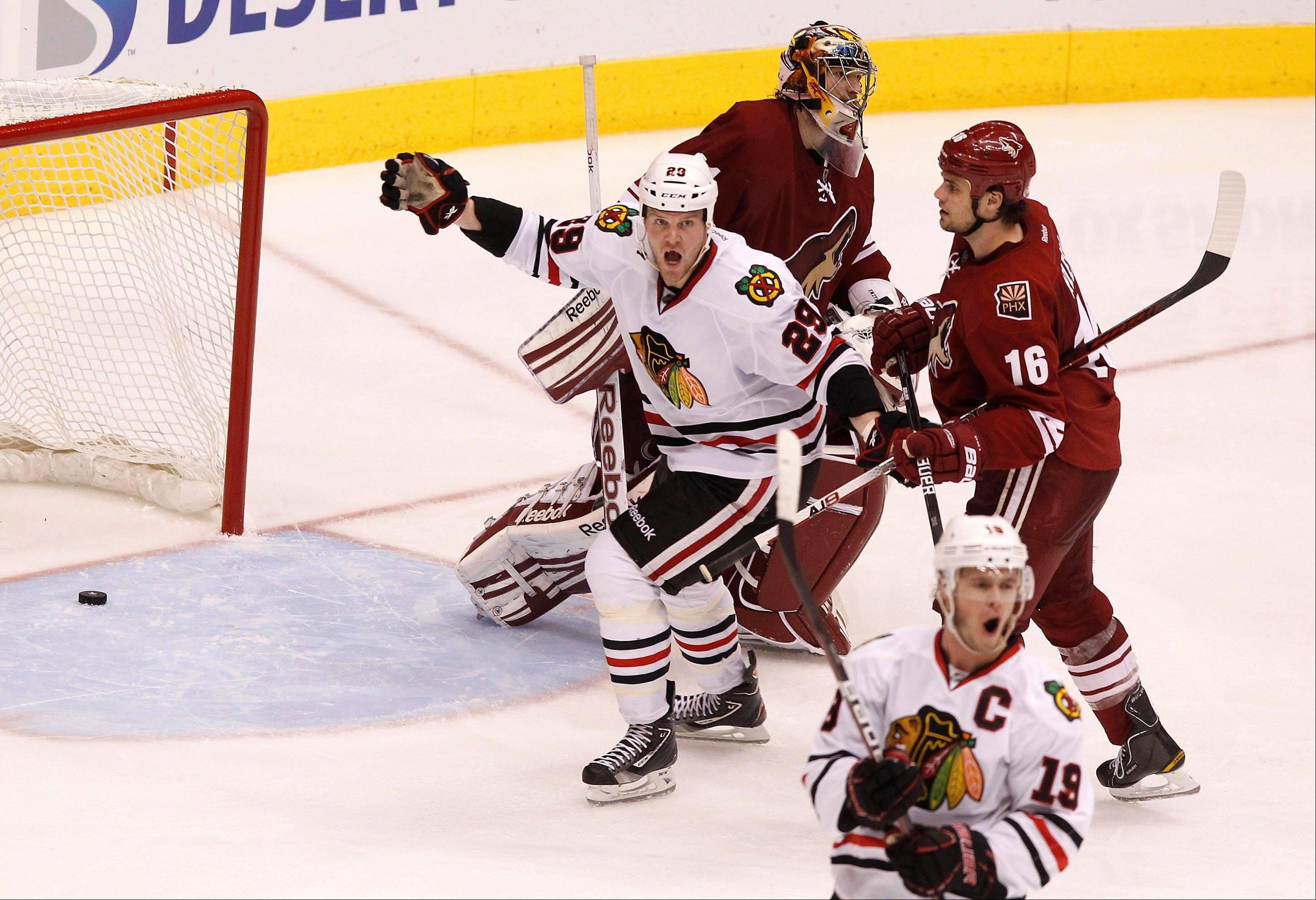 Blackhawks center Jonathan Toews celebrates his game-winning goal as teammate Bryan Bickell (29) joins him in celebration as the Phoenix Coyotes' Rostislav Klesla and goalie Mike Smith skate away Saturday during overtime in Game 5 in Glendale, Ariz. The Blackhawks defeated the Coyotes 2-1.