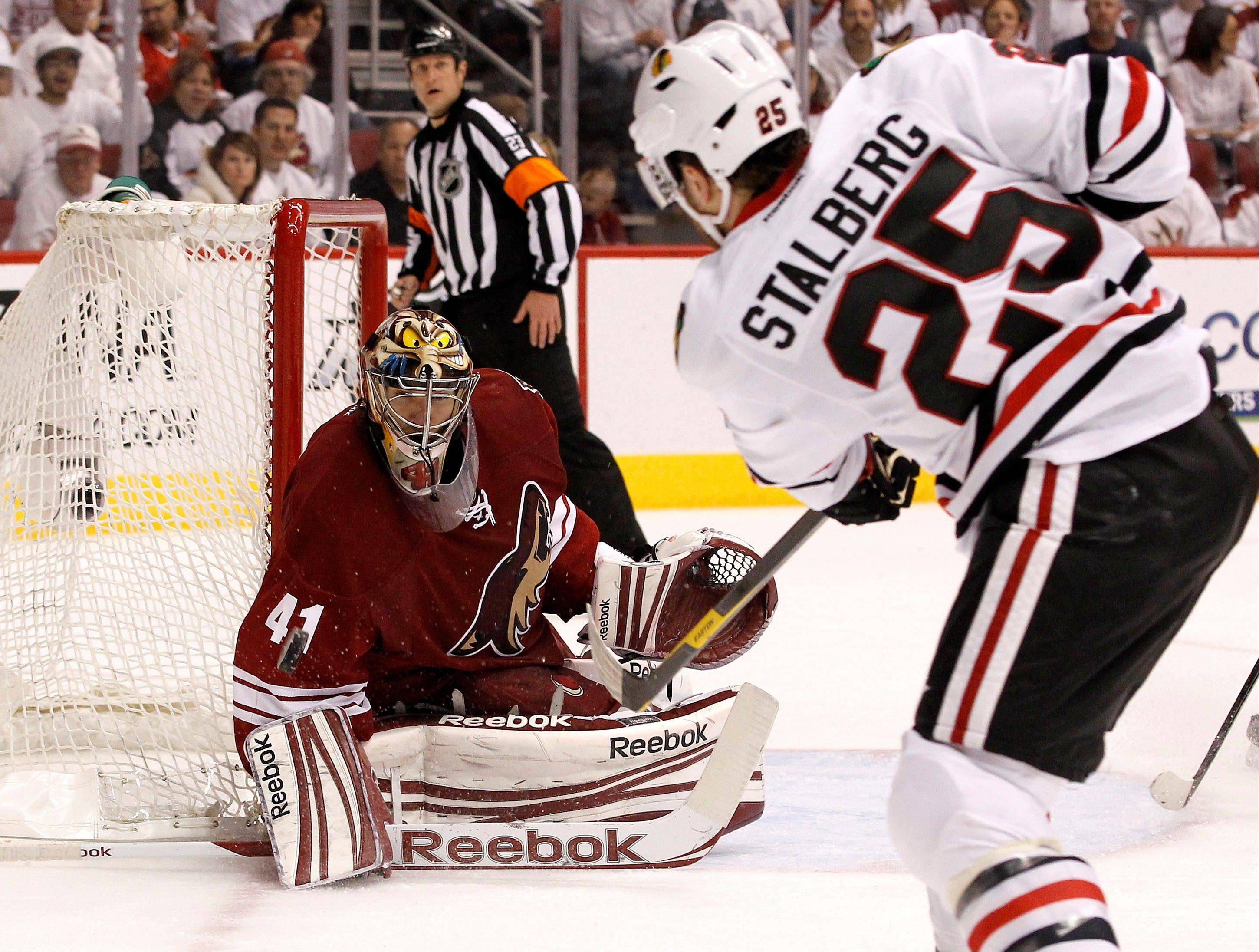 Chicago Blackhawks' Viktor Stalberg (25), of Sweden, sends a shot at Phoenix Coyotes' Mike Smith (41), who makes the save, during the second period in Game 5 of an NHL hockey Stanley Cup first-round playoff series Saturday, April 21, 2012, in Glendale, Ariz.