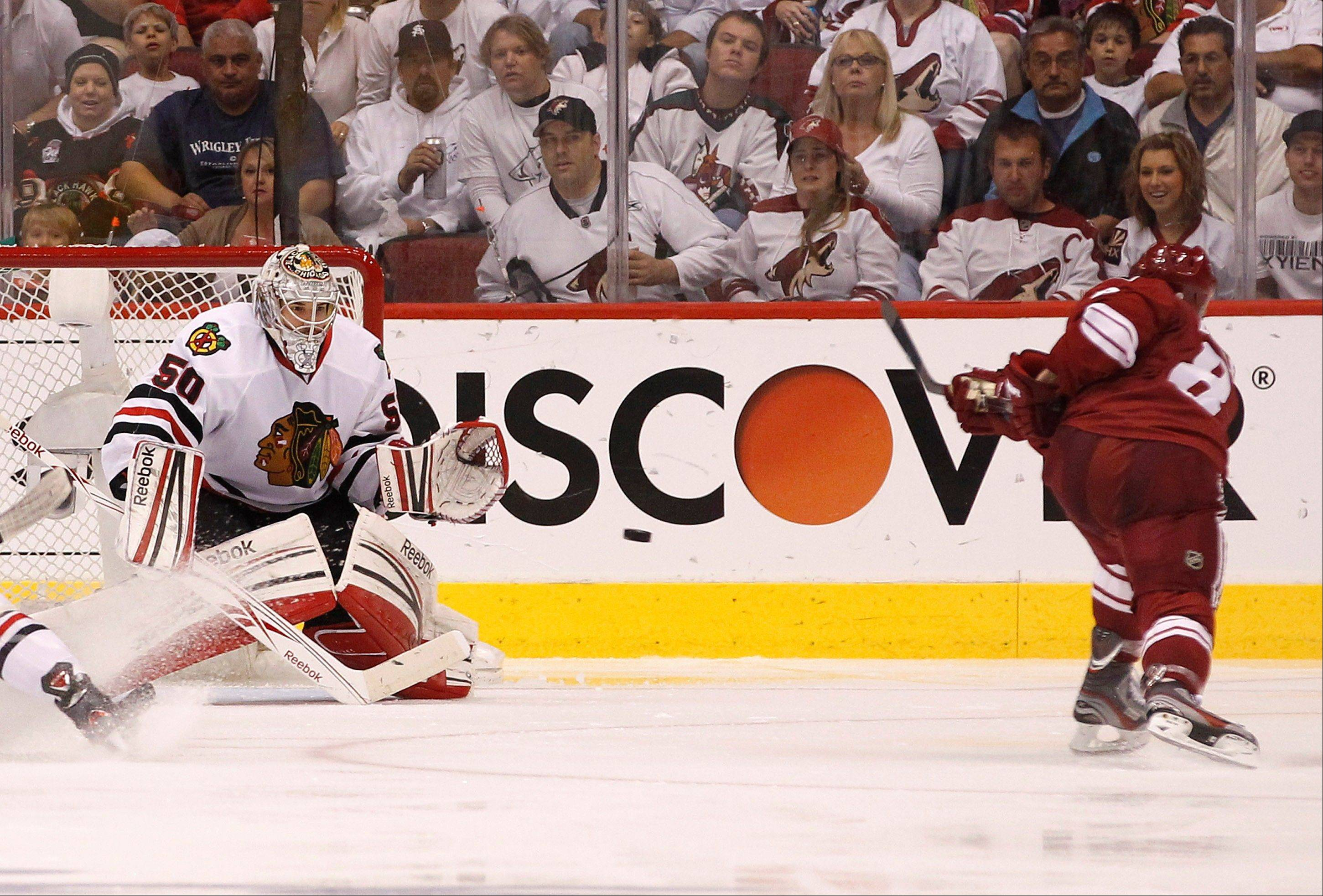 Phoenix Coyotes' Gilbert Brule (8) sends a shot past Chicago Blackhawks' Corey Crawford (50) for a goal during the second period in Game 5 of an NHL hockey Stanley Cup first-round playoff series Saturday, April 21, 2012, in Glendale, Ariz. AP Photo/Ross D. Franklin)