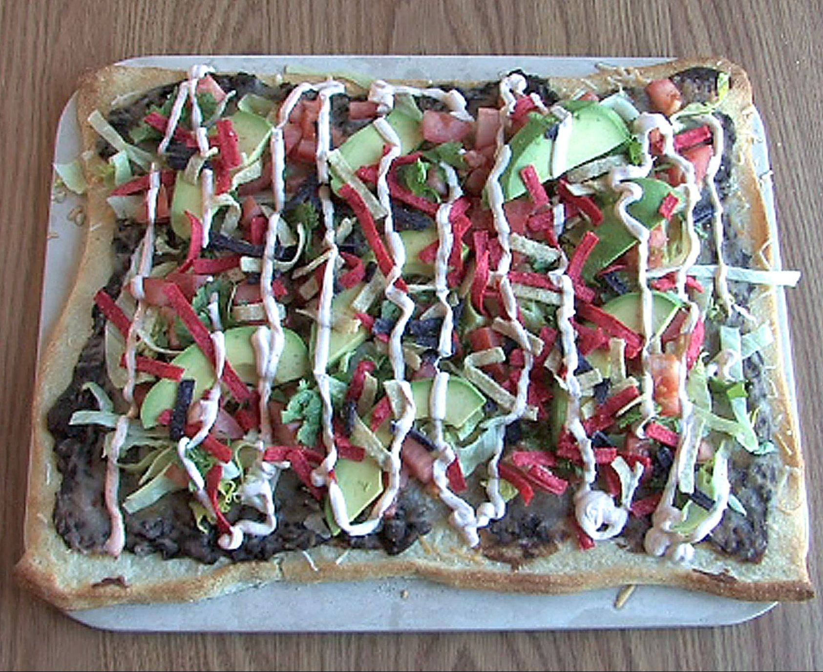 Taco Pizza made by Cooks of the Week Jennifer Loiseau and her 7-year-old daughter Maria in their Lake in the Hills kitchen. They produce an online video cooking blog called AmateurKitchen.tv