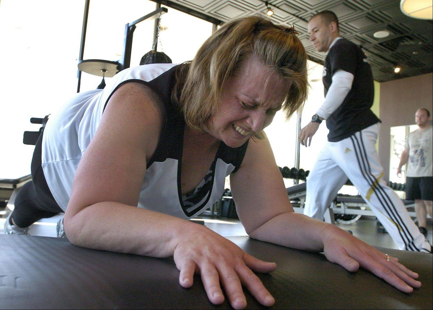 Fittest Loser Karen Maranto works out under the guidance of Push Fitness trainer Tony Figueroa.