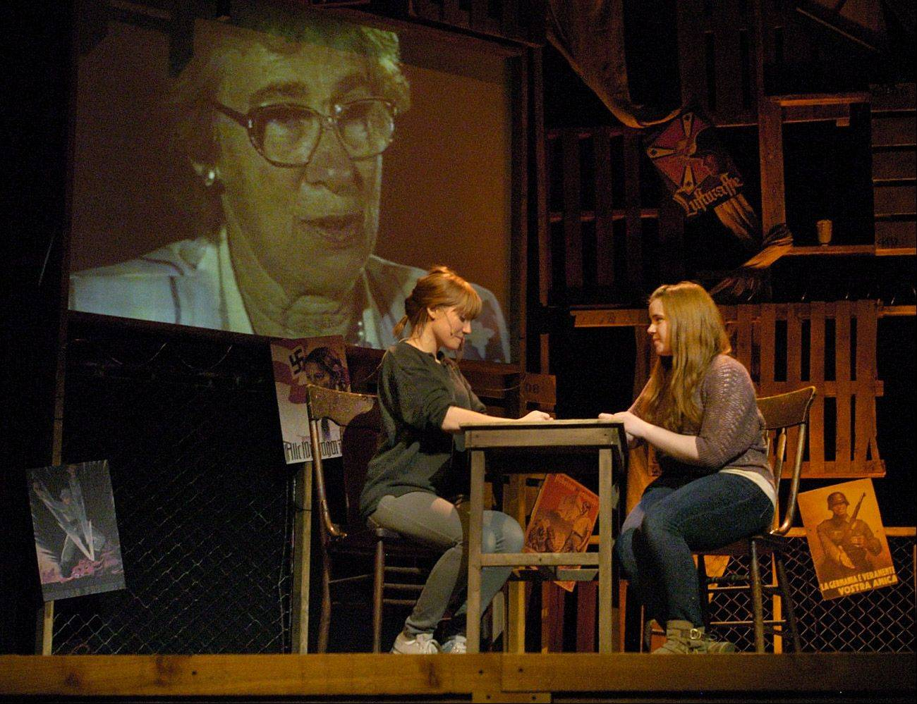 "Deirdre Savaria as Eva and Kelley Rochau as Mutti, rehearse a scene from ""And Then They Came For Me,"" with video of the real Eva Schloss in the background."