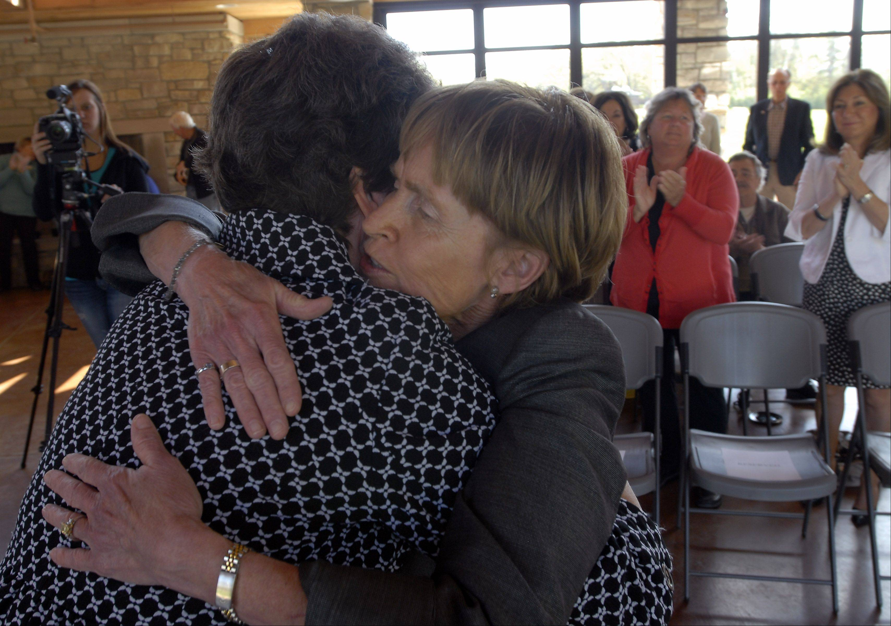 Dee Beaubien, right, hugs McHenry County Board member Donna Kurtz Monday in Barrington just before announcing her candidacy in the 52nd District House race. If she obtains enough petition signatures, she'll run as an independent against Republican David McSweeney.