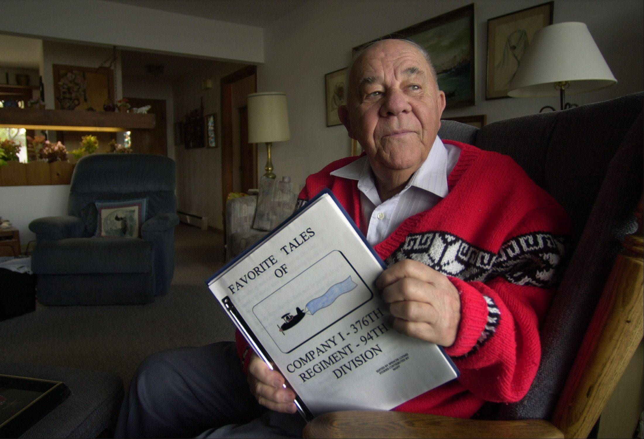 Spencer Loomis of Lake Zurich with his self-published book about his experiences in World War II.
