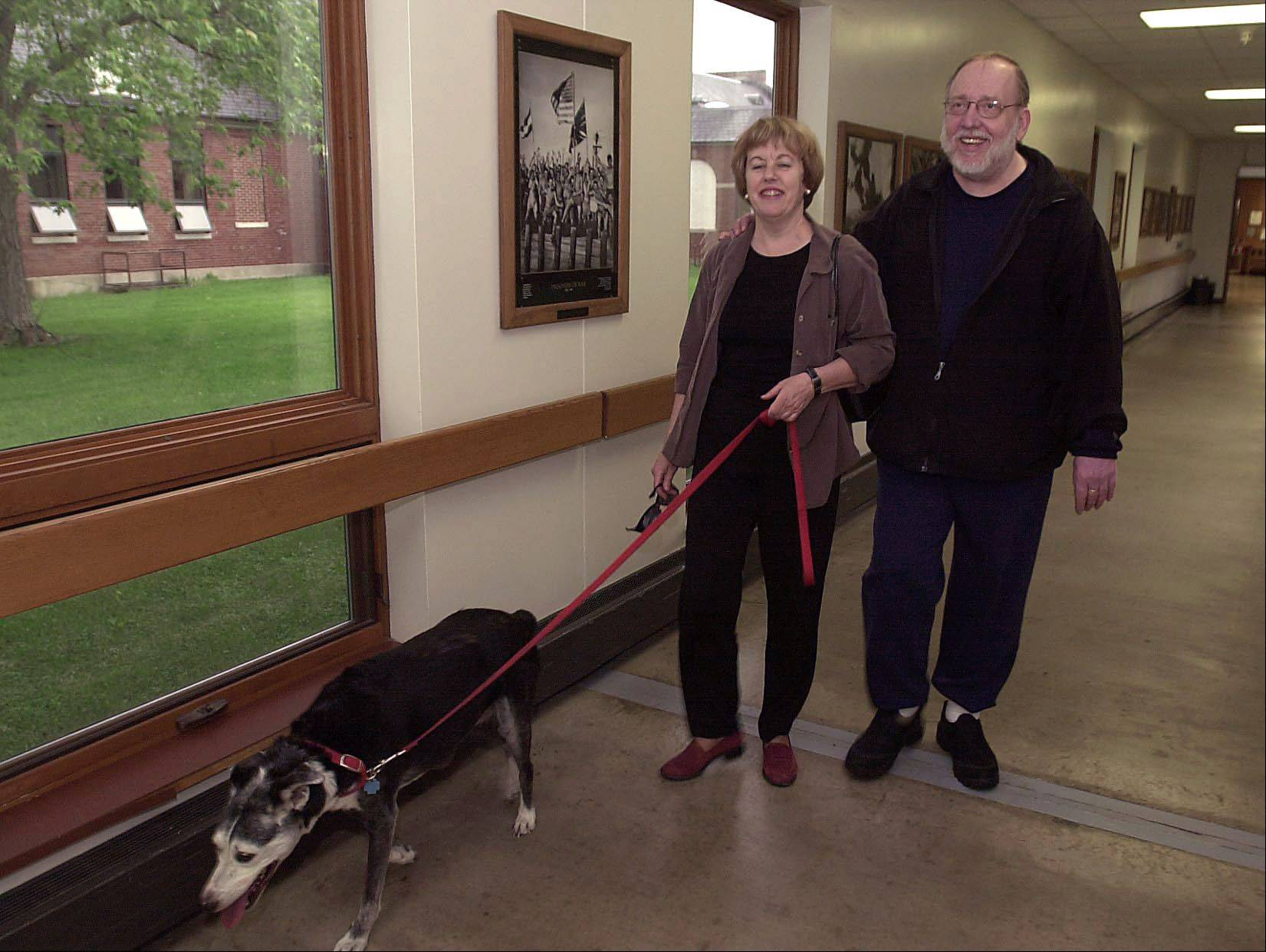Bill and his wife, Lori, walk their dog Banner in the halls at the VA Hospital in Manteno in 2003.