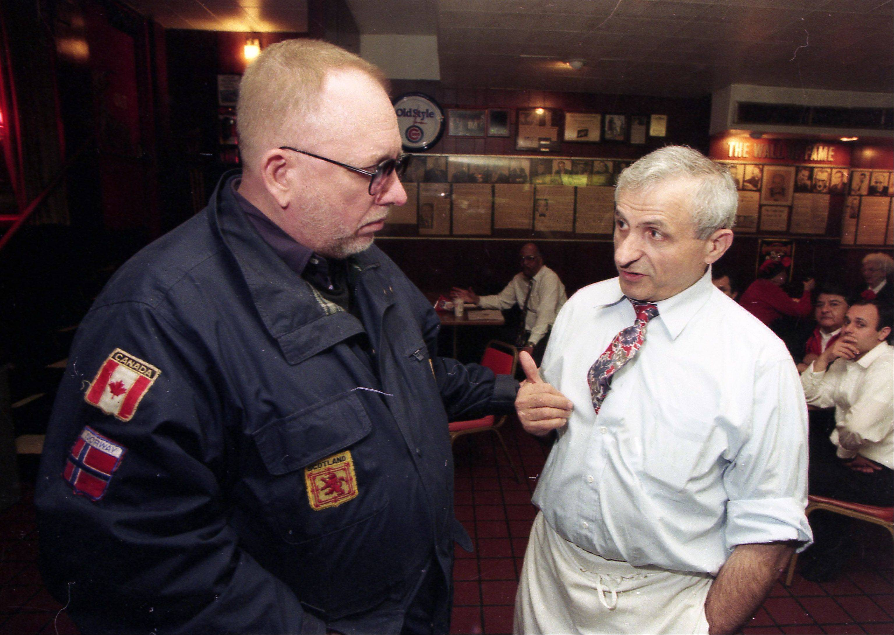 Bill Granger, left, talks with Sam Sianis, owner of the Billy Goat Tavern in Chicago, in 1997.