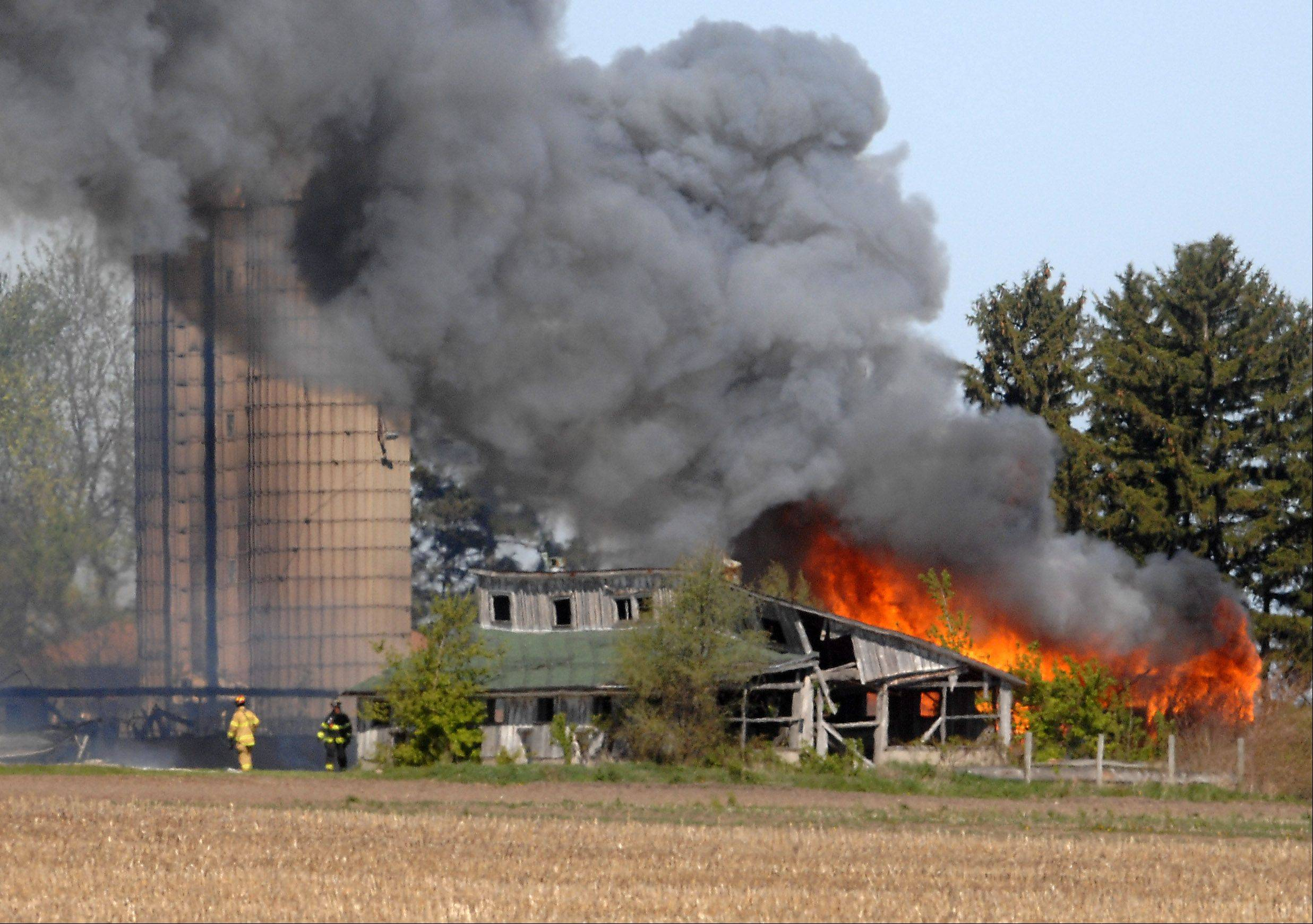 "Multiple fire departments responded to a ""fully-involved"" barn fire on Route 47 near Lily Lake Monday morning."