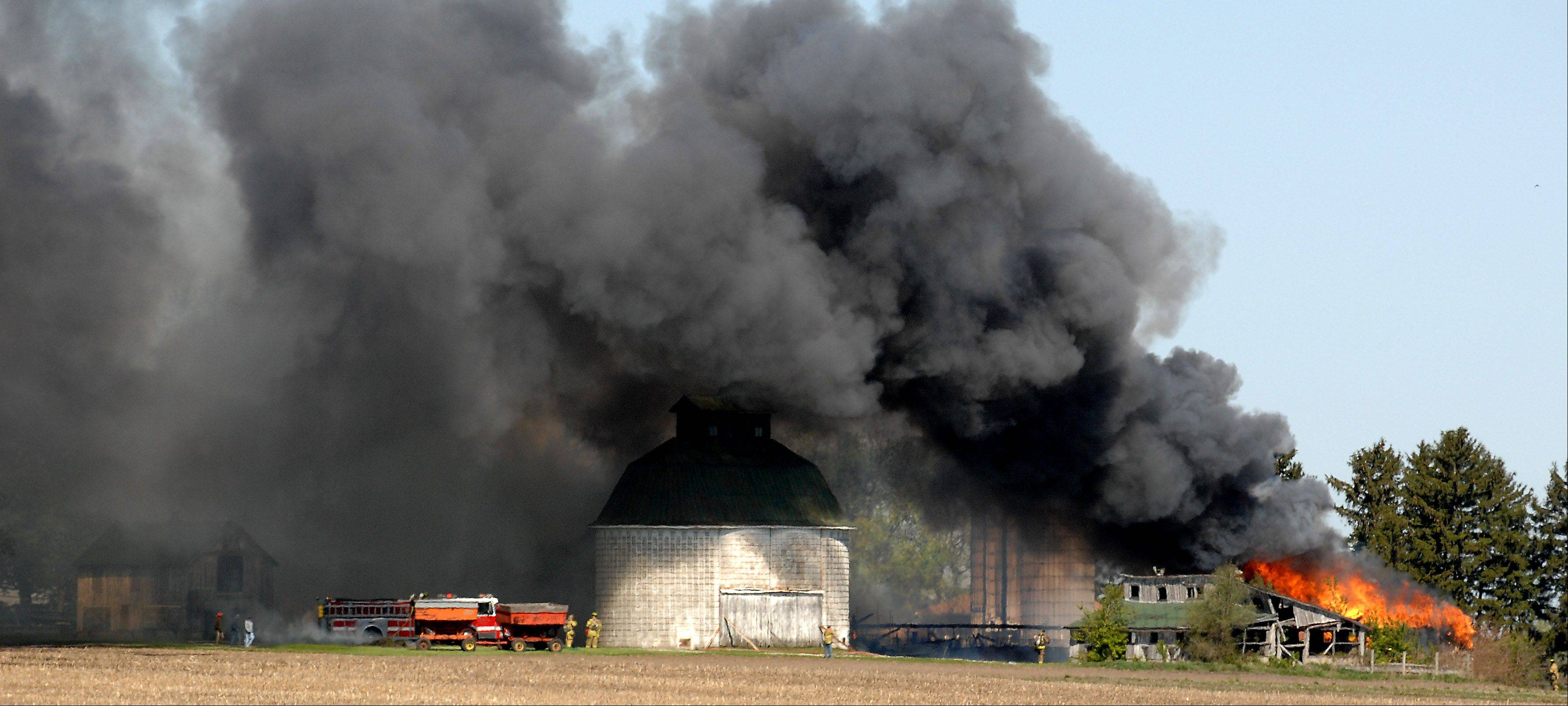 "Multiple fire departments responded to a ""fully-involved"" barn fire in the 6N500 block of Route 47 near Lily Lake Monday morning. Fire officials did not immediately have a cause for the fire."