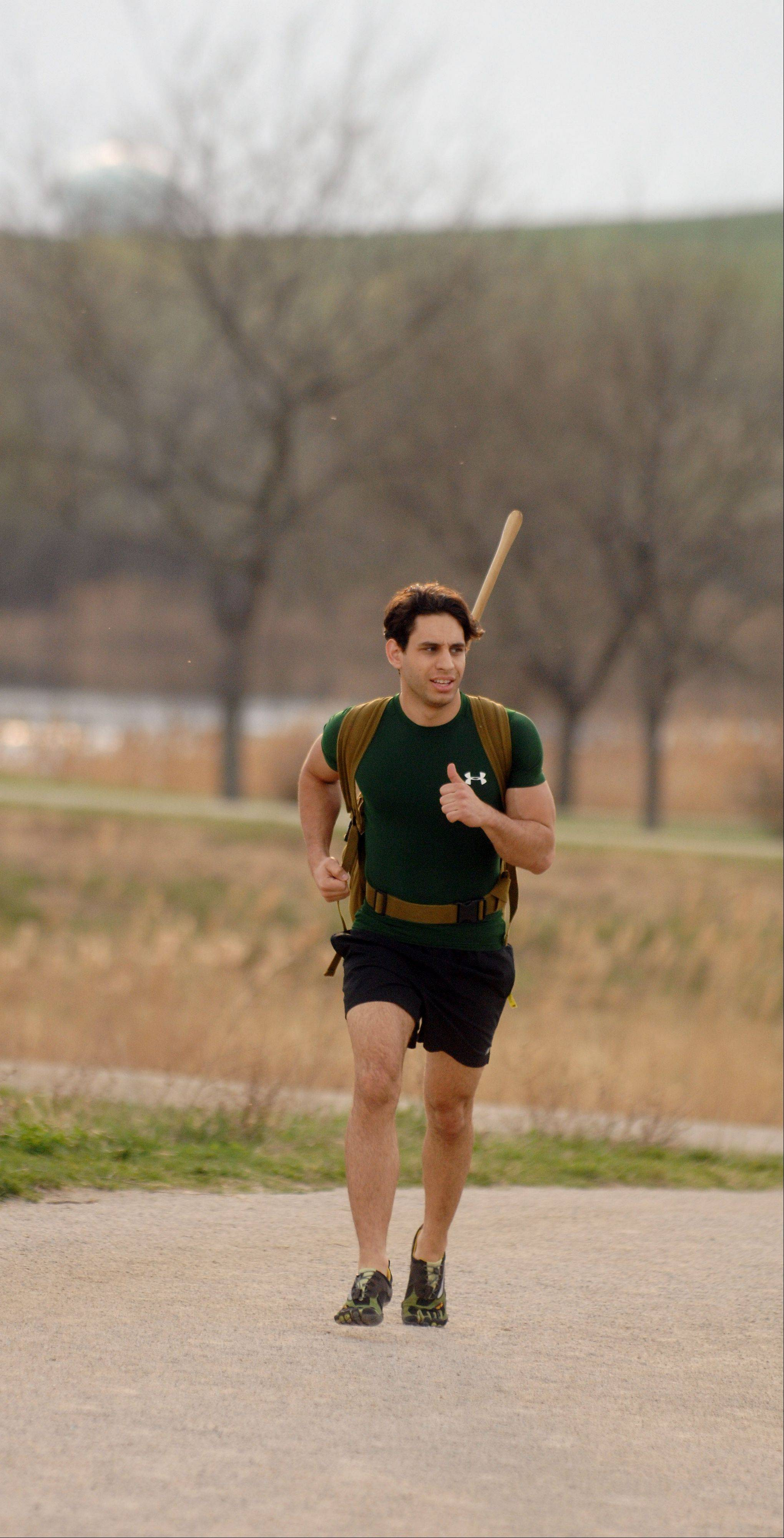 Anthony Matesi of Carol Stream runs laps at Mallard Lake Forest Preserve near Hanover Park as part of his training for the Spartan Death Race in June.