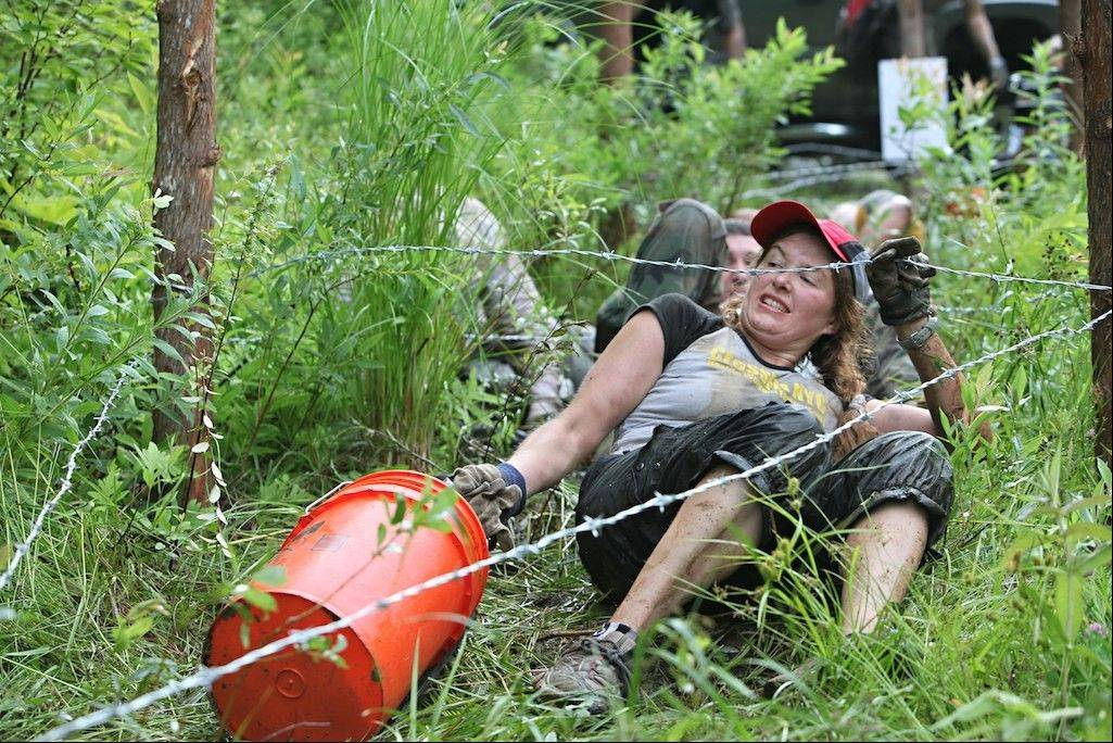 A contestant crawls under barbed wire -- one of the many obstacles thrown at her during the 2010 Spartan Death Race.