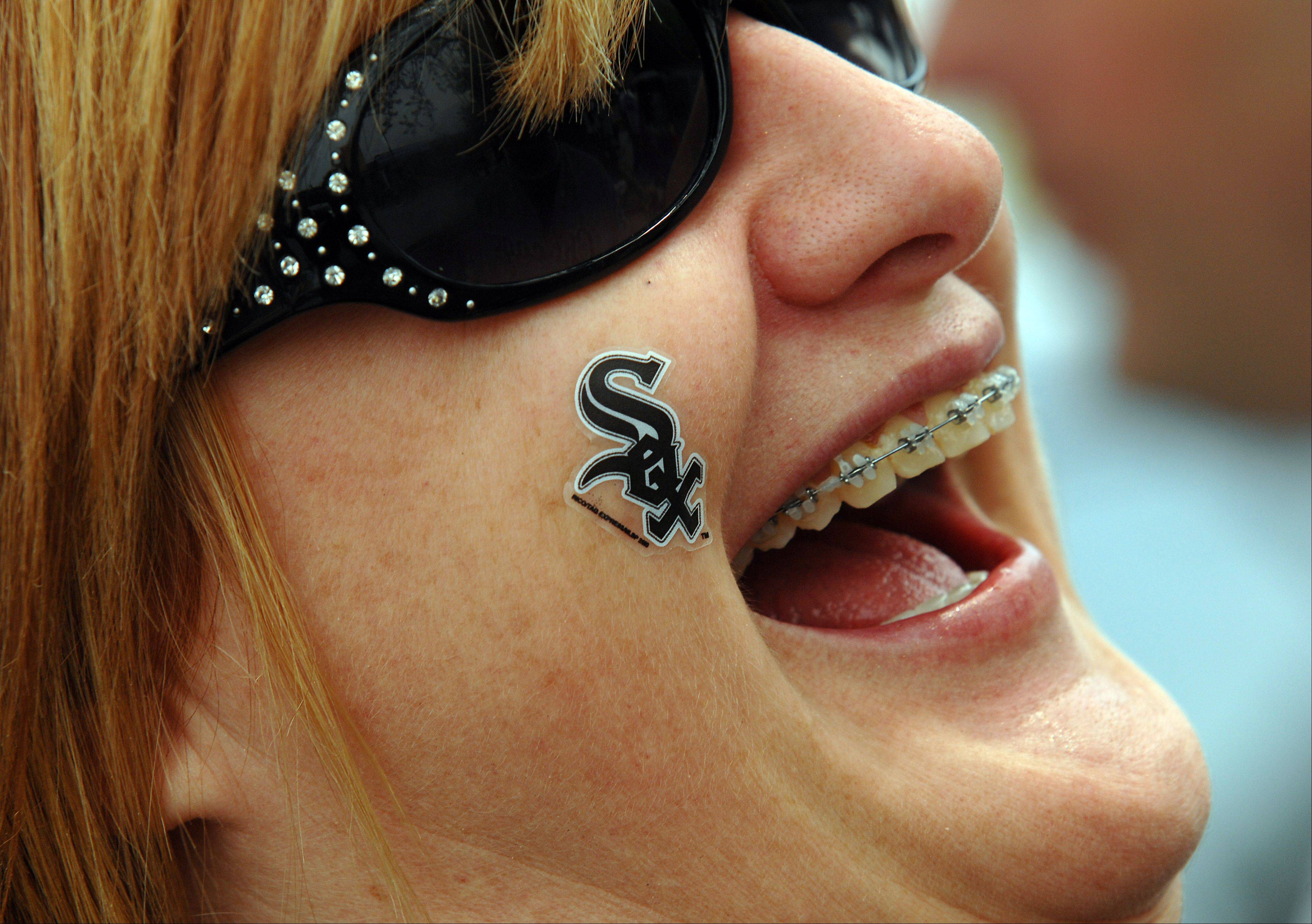 White Sox fan Carol Everett of Bolingbrook greets opening day with a smile and a laugh.