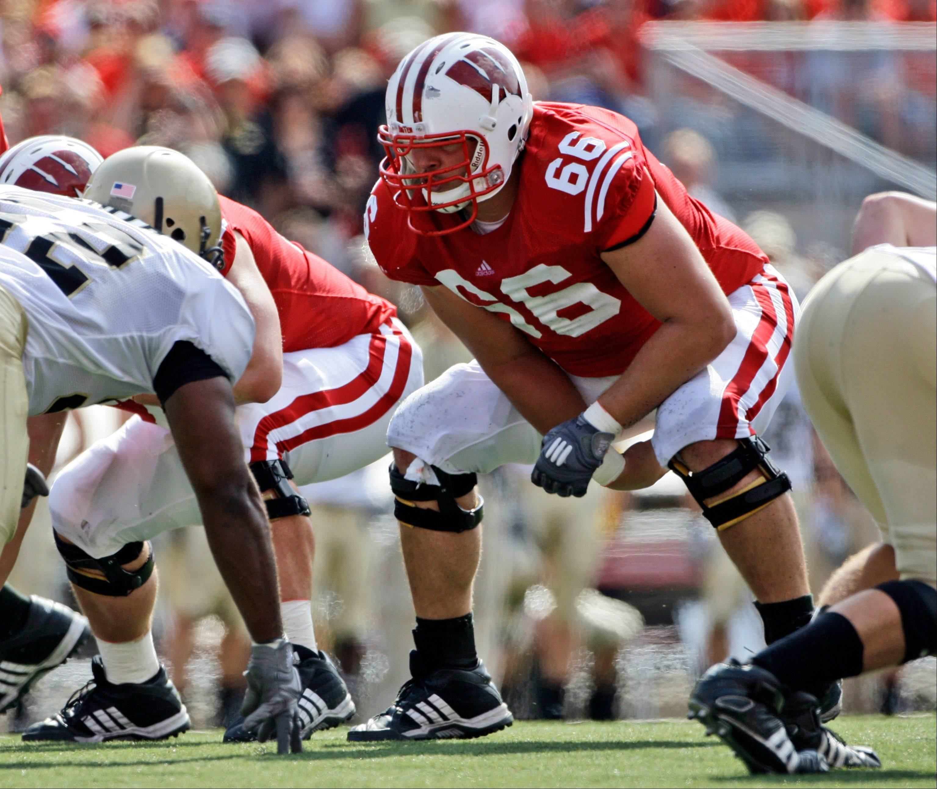 In this Sept. 19, 2009, file photo, Wisconsin's Peter Konz (66) lines up during the first half of an NCAA football game in Madison, Wis. Konz is a top prospect in the upcoming NFL football draft. The 6-foot-5, 314-pound Konz could be tabbed as early as the end of the first round.