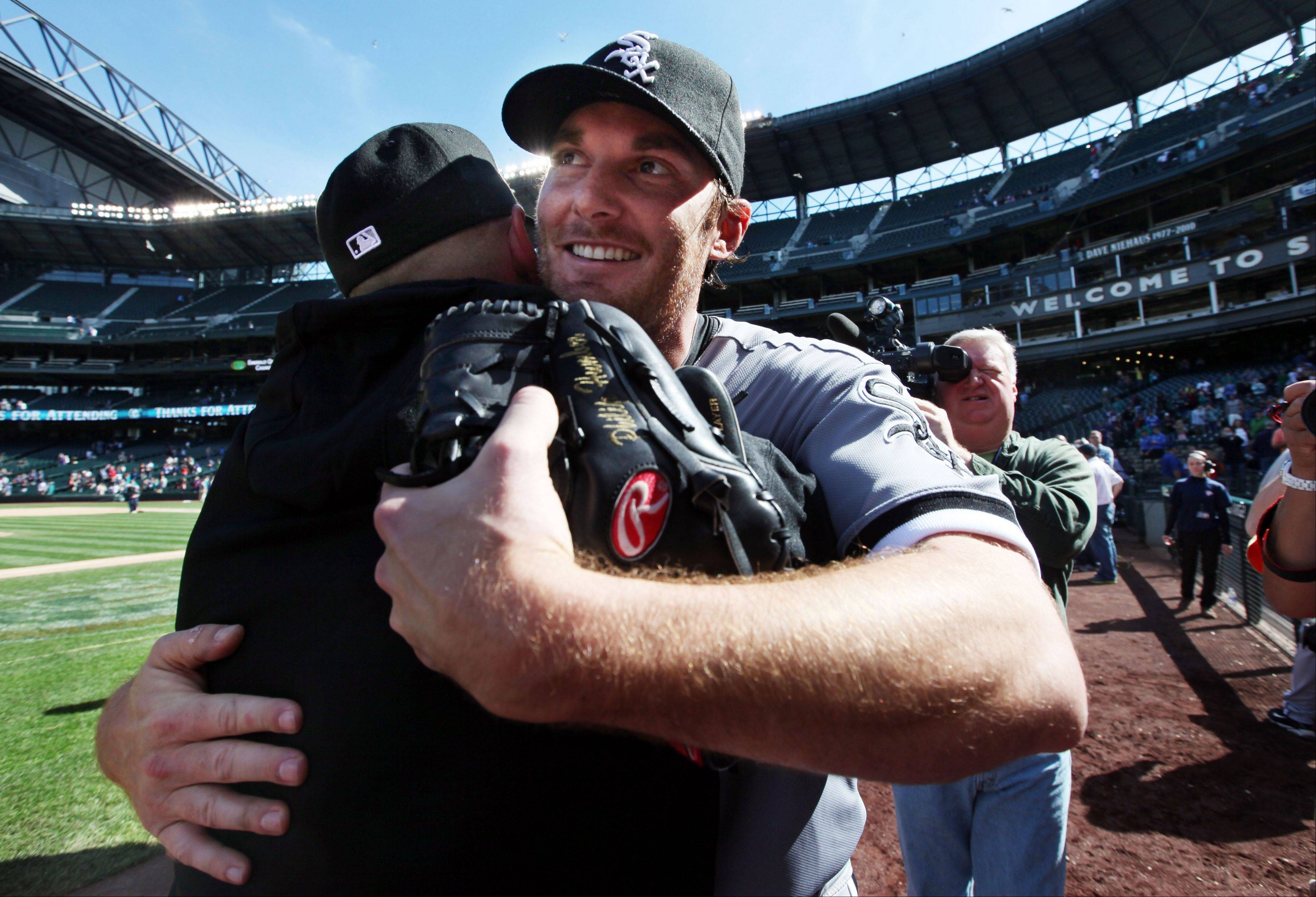 White Sox starting pitcher Phil Humber is embraced after pitching a perfect baseball game Saturday in Seattle against the Mariners. Humber is scheduled to pitch Thursday against the Boston Red Sox at U.S. Cellular Field.