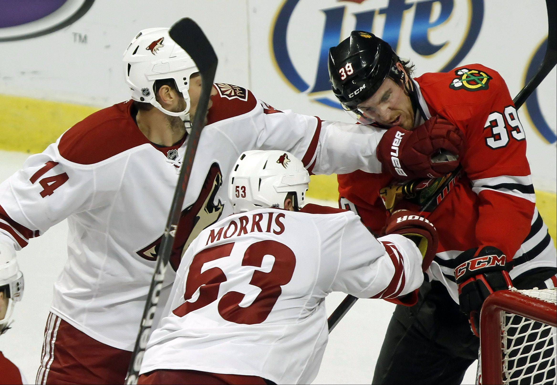 Chicago Blackhawks' center Dave Bolland and defenseman Duncan Keith collide.