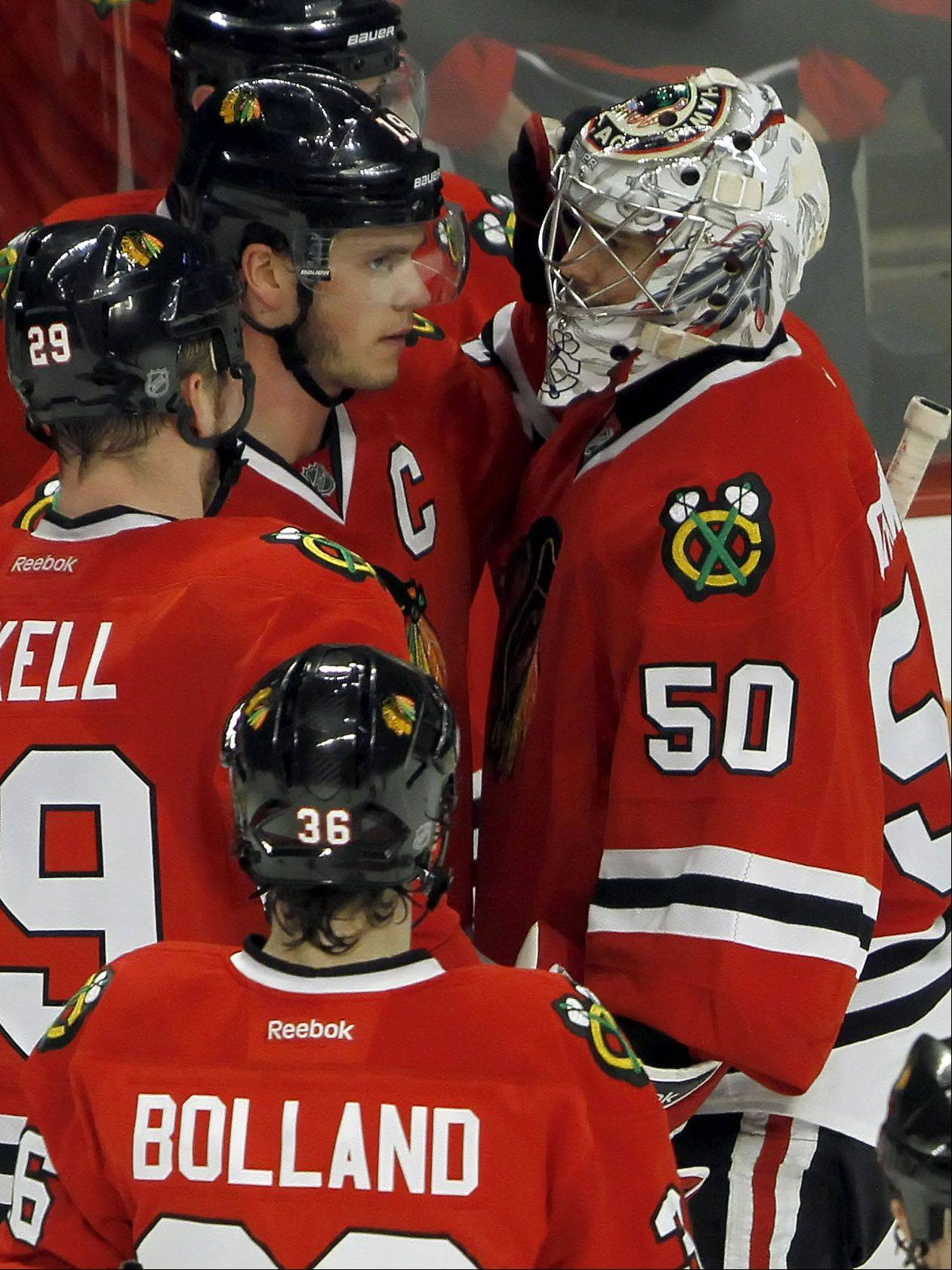 Chicago Blackhawks' center Jonathan Toews consoles goalie Corey Crawford.
