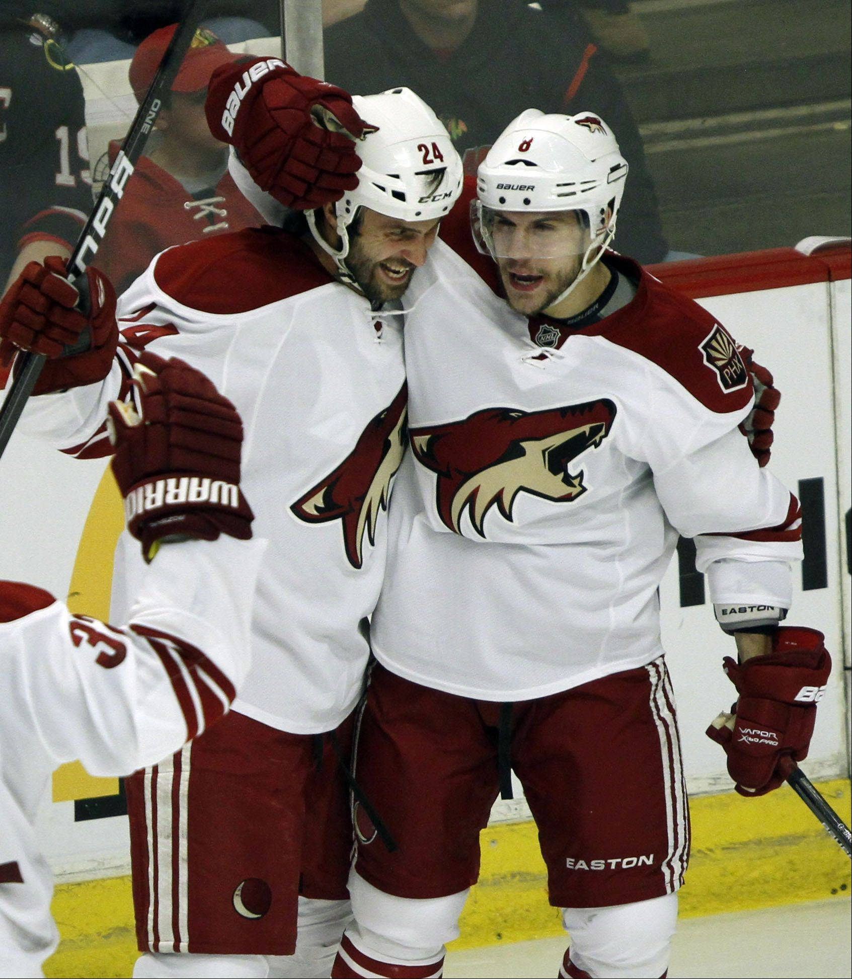 Phoenix Coyotes' center Kyle Chipchura and Phoenix Coyotes center Gilbert Brule celebrate.