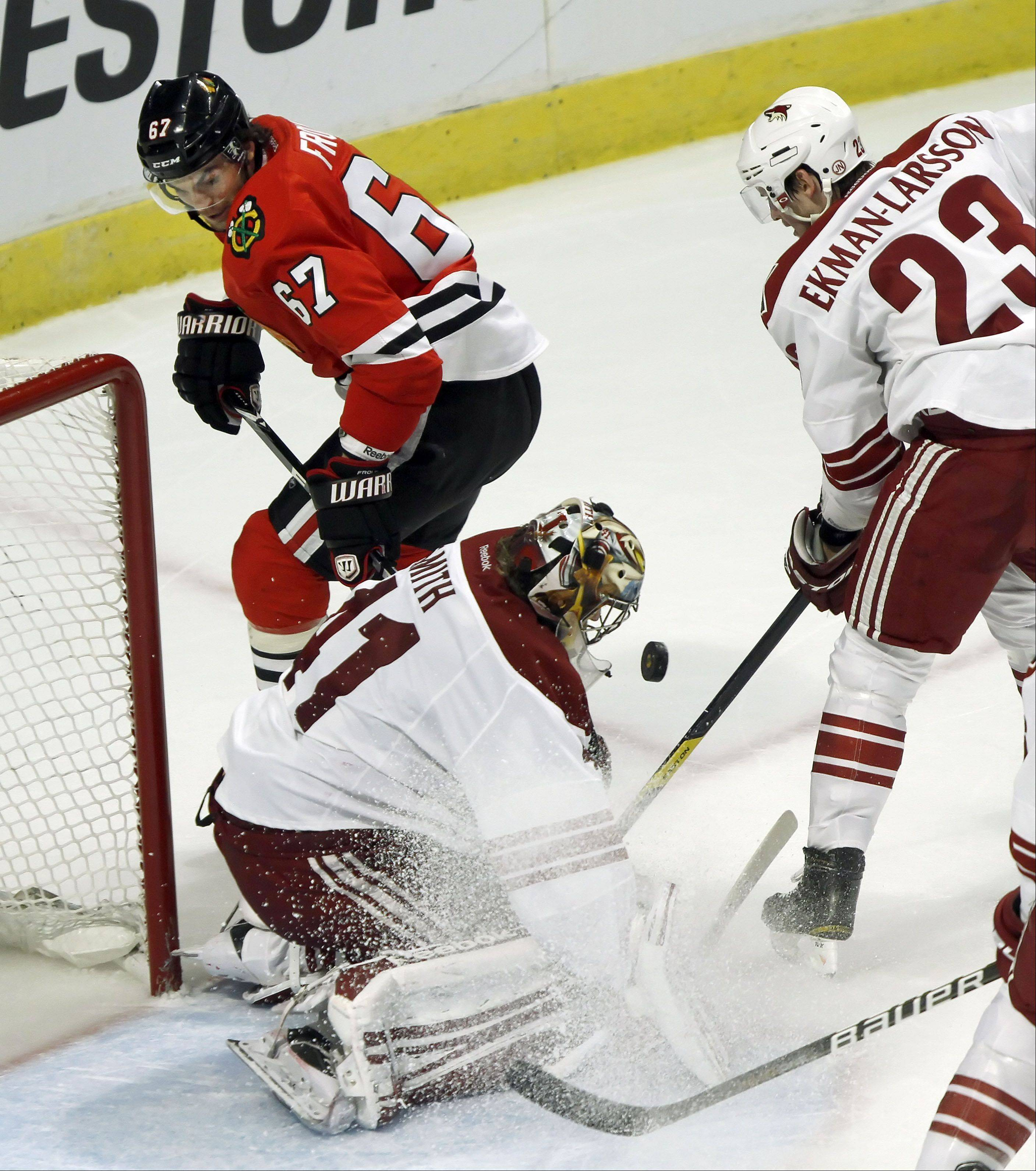 Chicago Blackhawks' right wing Michael Frolik shoots on Phoenix Coyotes' goalie Mike Smith.