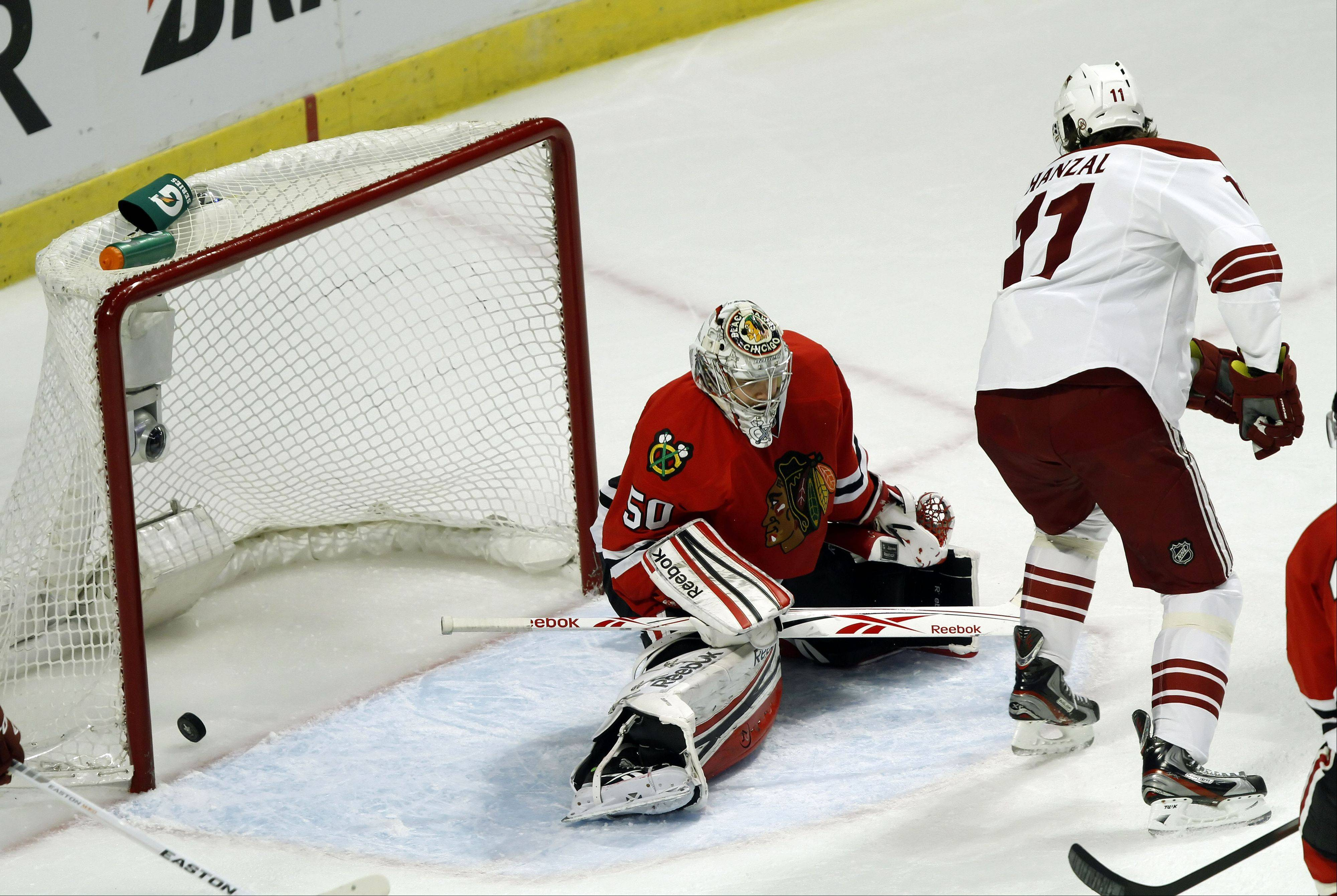 Chicago Blackhawks' goalie Corey Crawford allows a goal in the second period.