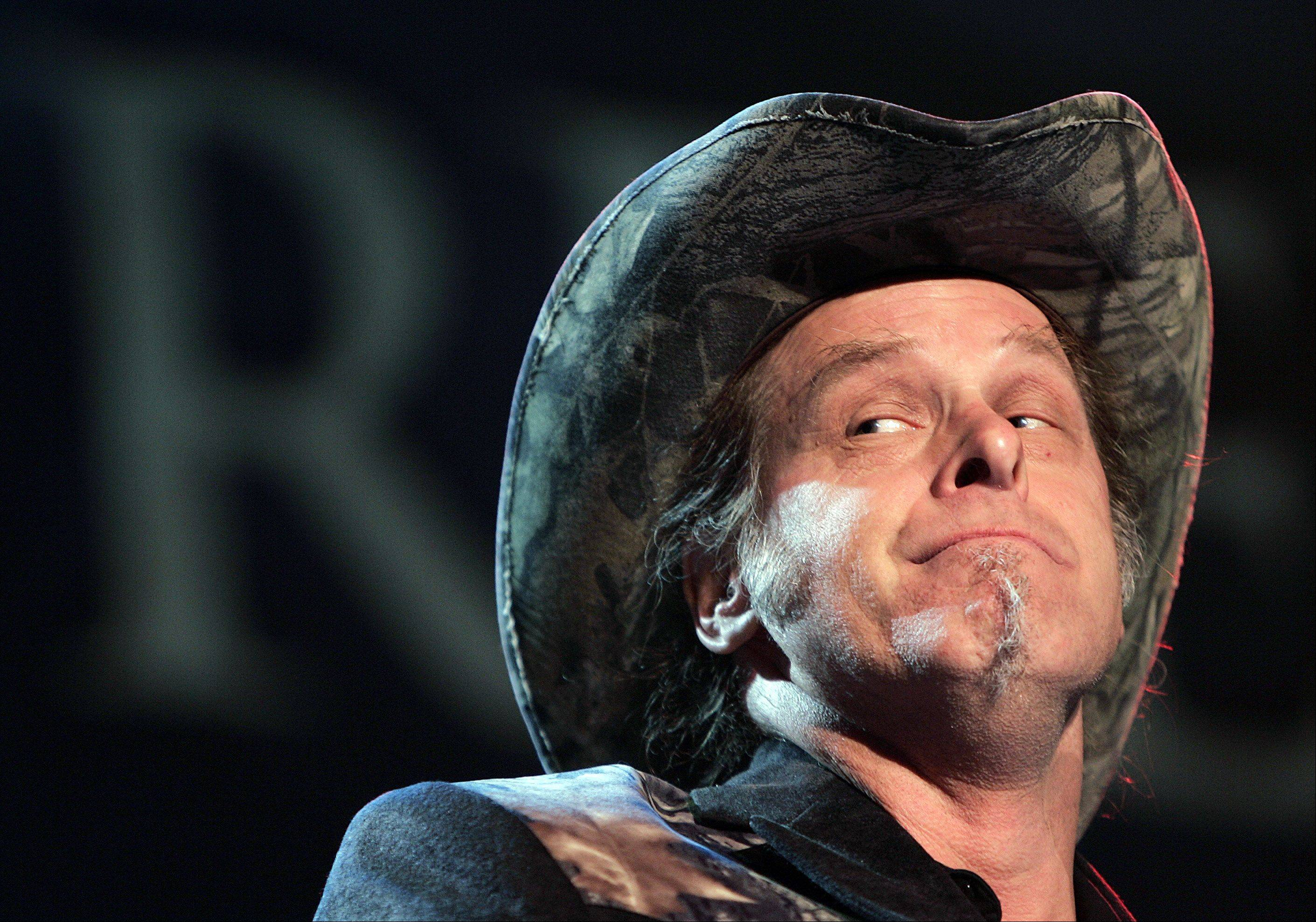 Ted Nugent performs during the opening ceremony of the 2006 National Rifle Association annual convention in Milwaukee.