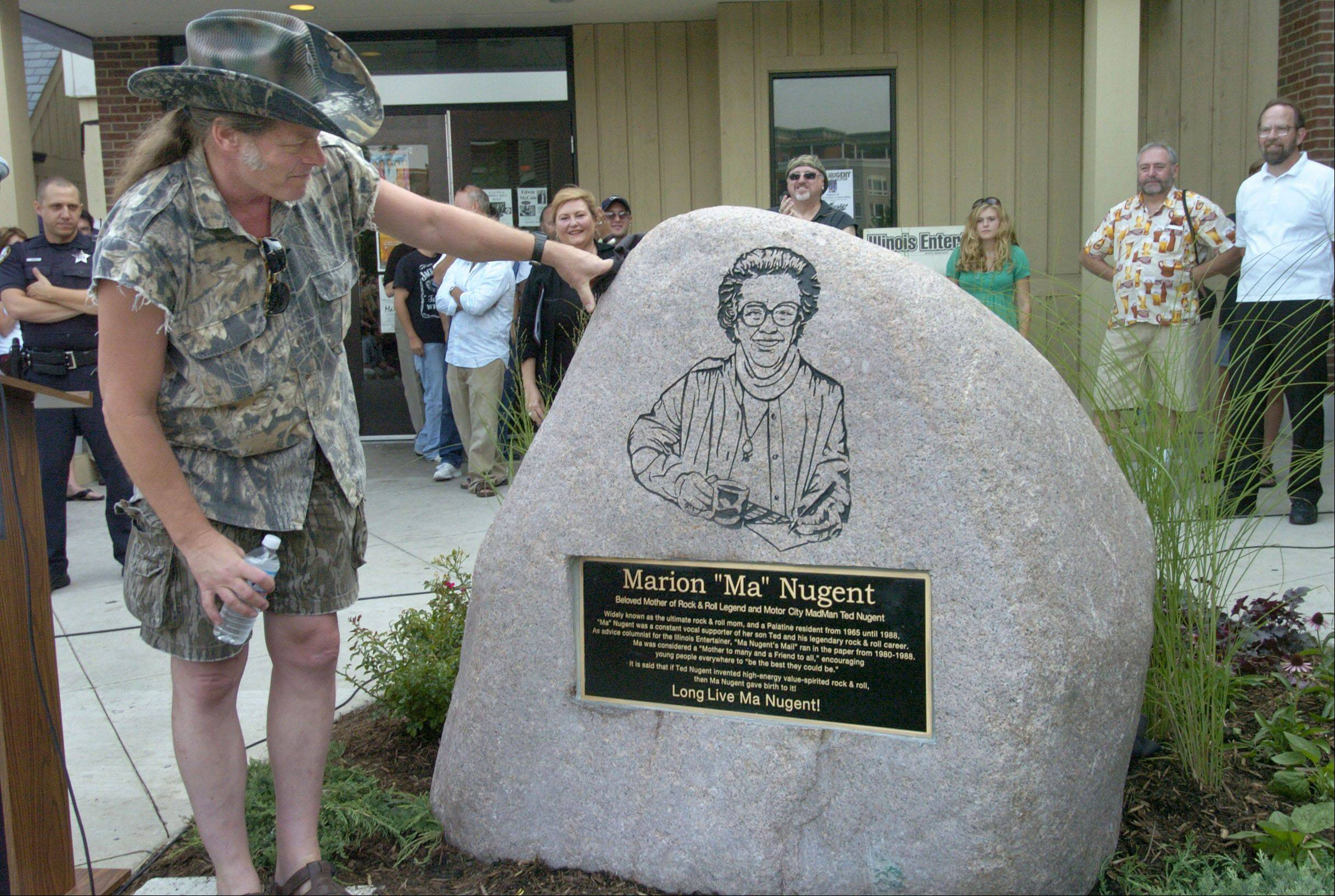 "Ted Nugent admires the monument put in front of Durty Nellie's in Palatine, in memory of his mother, longtime Palatine resident Marion ""Ma"" Nugent."