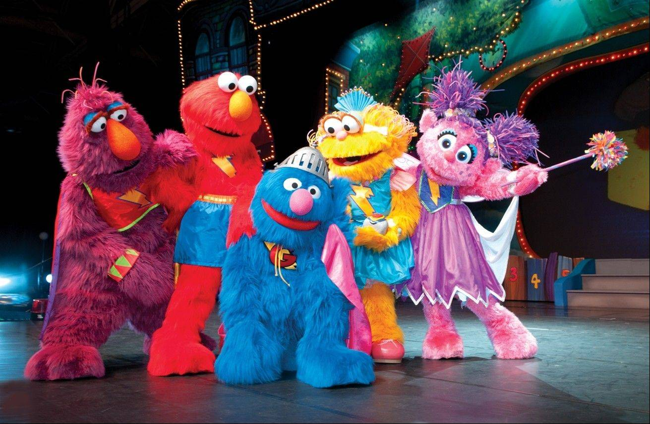 "When Super Grover, center, loses his powers, his friends Telly Monster, Elmo, Zoe and Abby Cadabby help to recover them in Sesame Street Live's ""Elmo's Super Heroes,"" which plays at the Akoo Theatre at Rosemont from Thursday through Sunday, May 3-6."