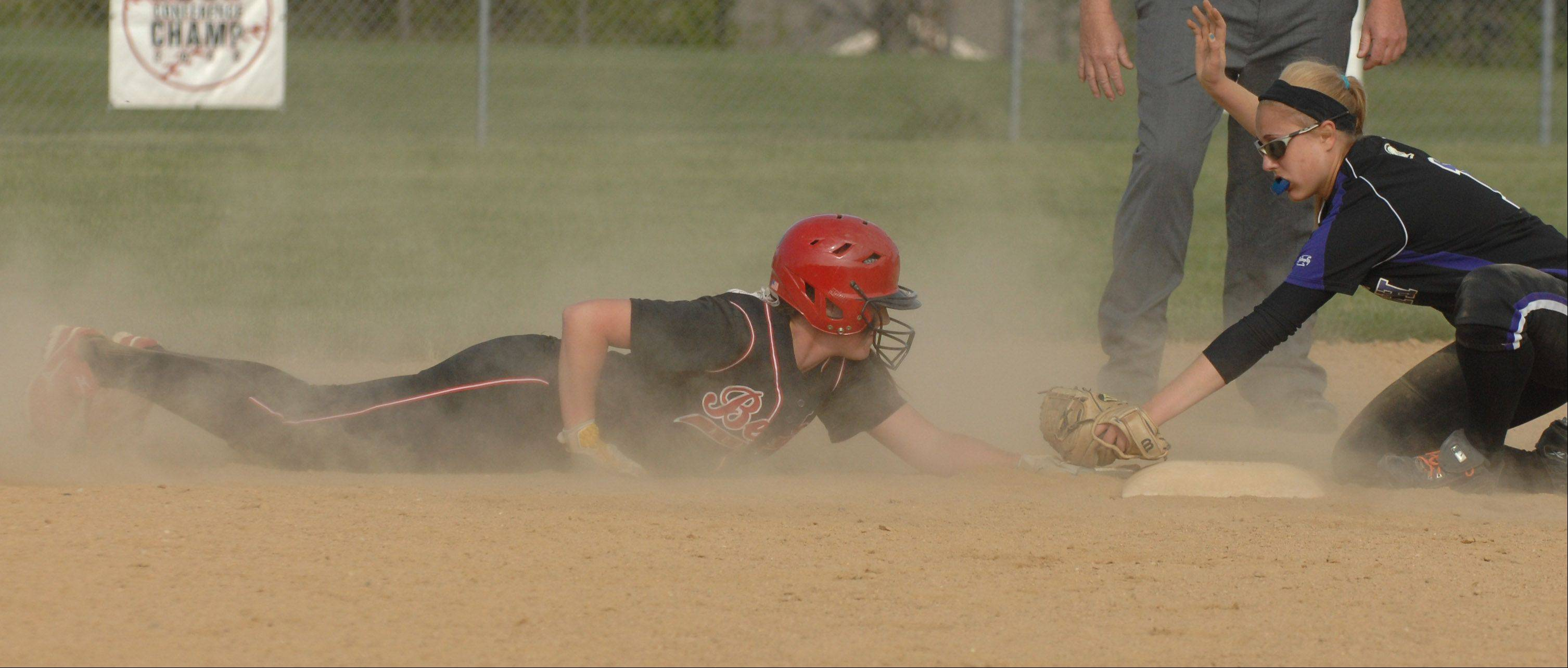 Maeve McGuire of Benet is tagged out by Maddie Wojciak of Downers Grove during the Downers Grove North at Benet softball game Tuesday.