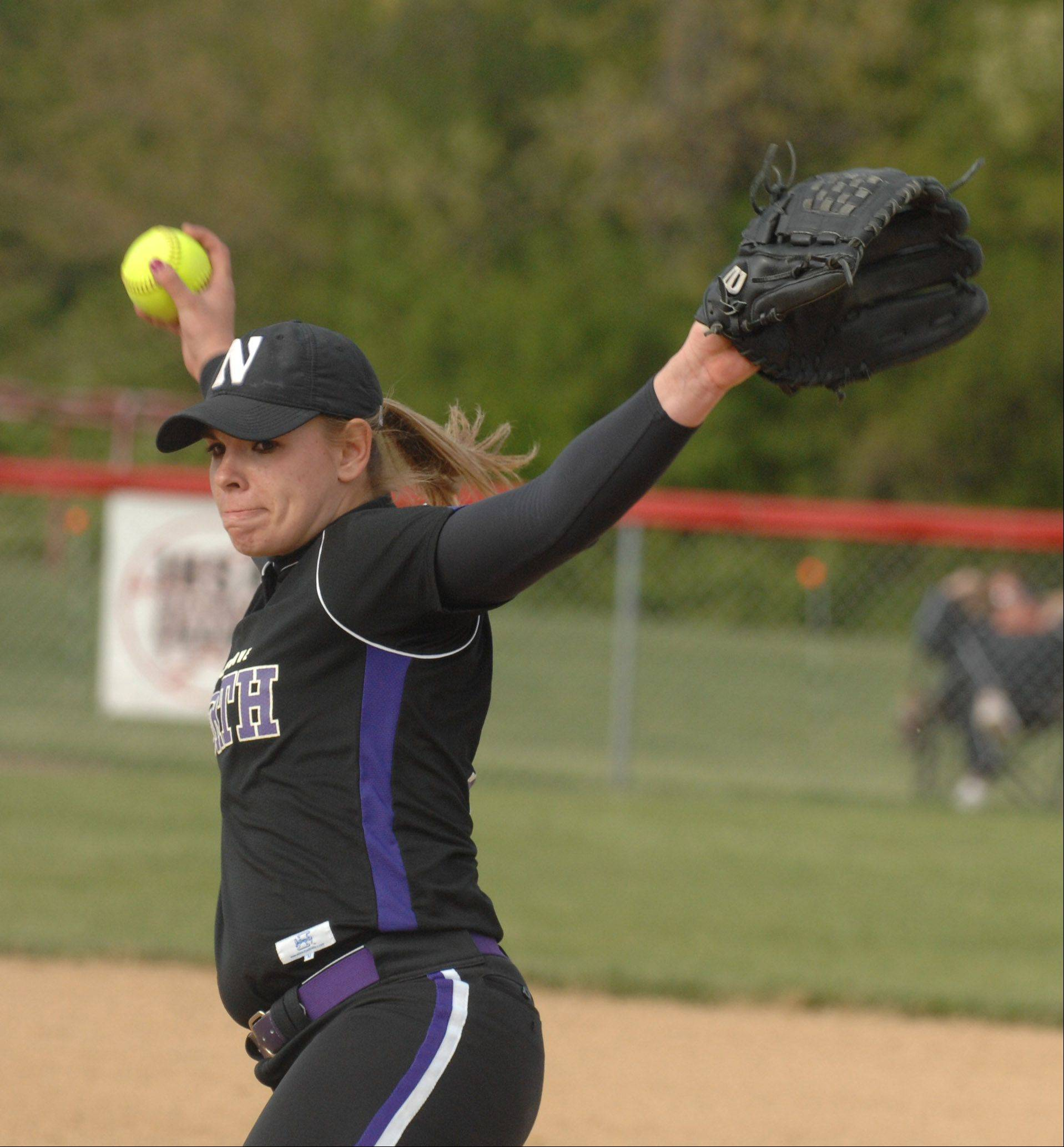 Elaina Heflin of Downers Grobe pitches during the Downers Grove North at Benet softball game Tuesday.