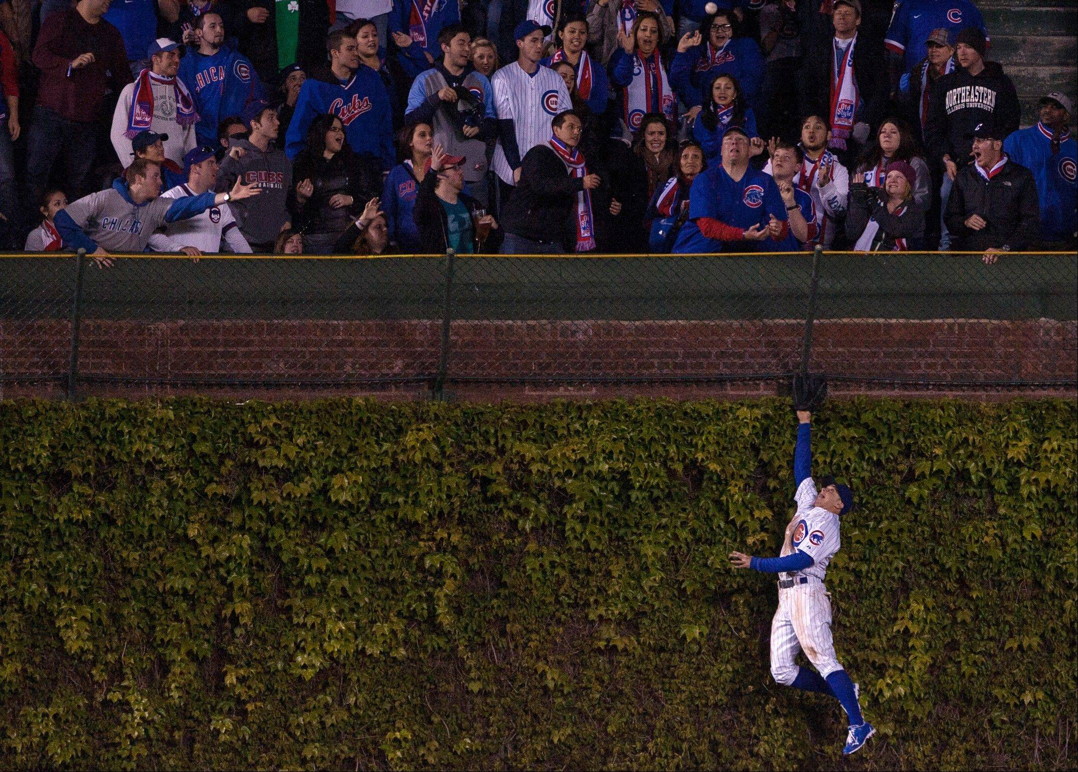 The Cubs' Tony Campana can't make the catch on a 2-run home run by St. Louis Cardinals' Matt Holliday during the eighth inning of their game Tuesday at Wrigley Field.