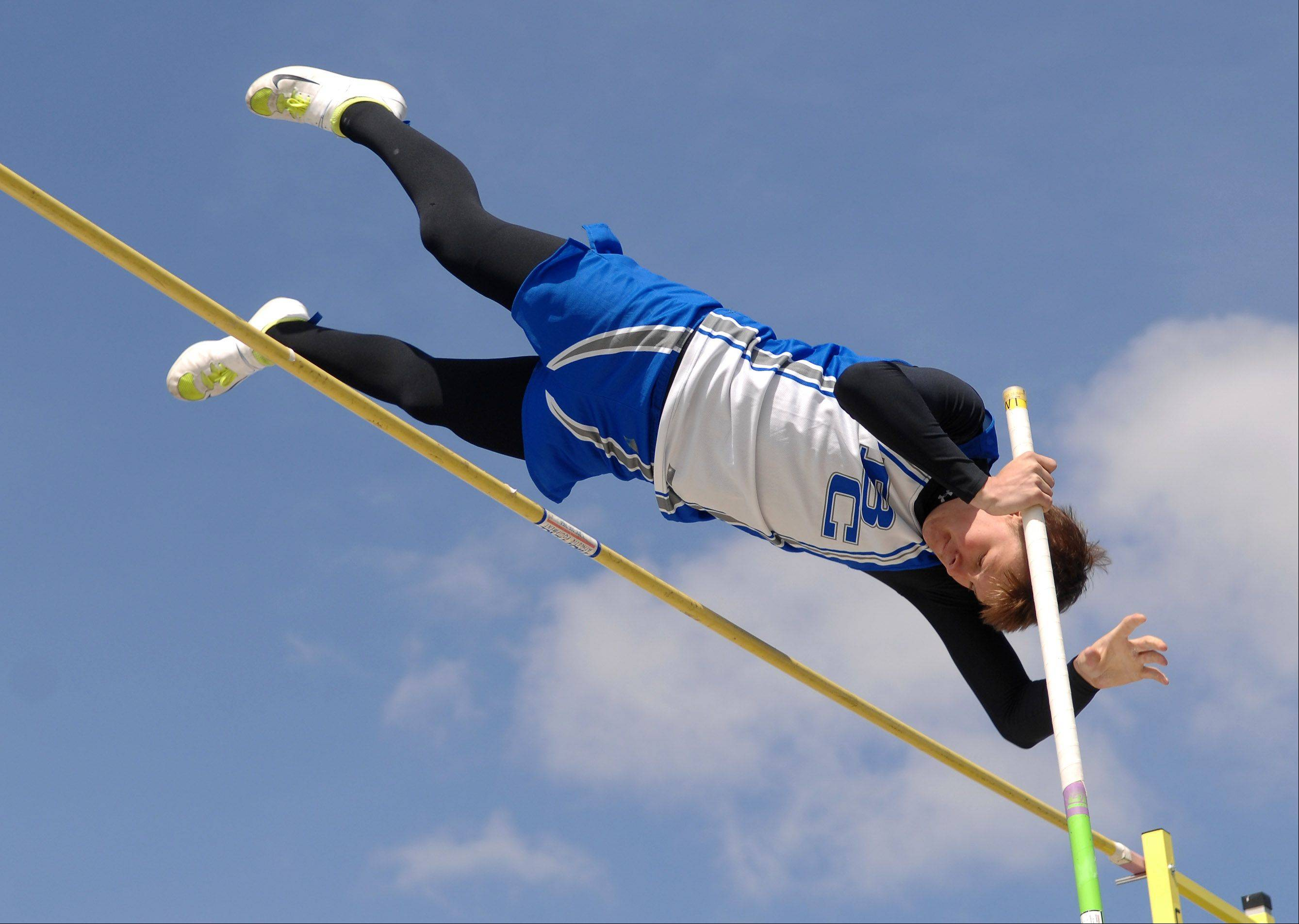 Burlington Central's Kyle Ingraham clears the bar in the pole vault during the Peterson Prep Invitational boys track meet at Kaneland High School in Maple Park Saturday.