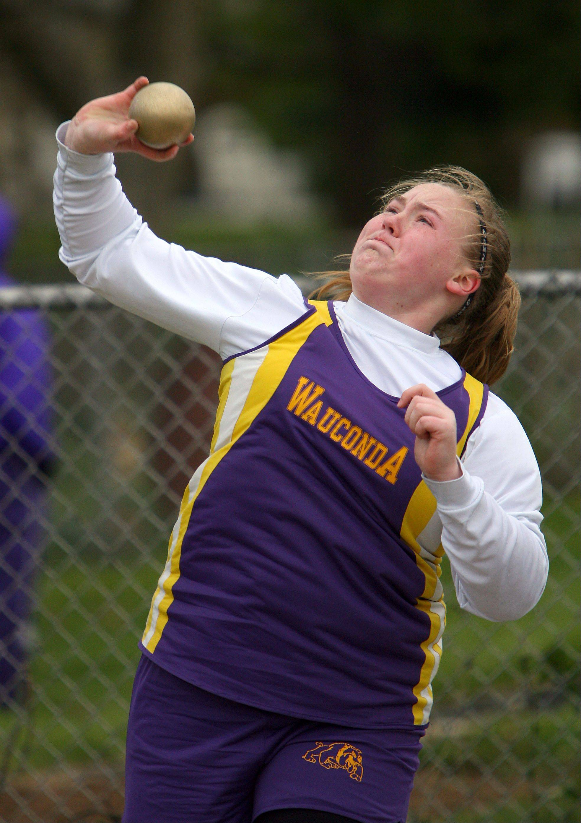 Wauconda's Christina Meinhardt competes in the shot put during the Wauconda Girls Track Invitational Friday.