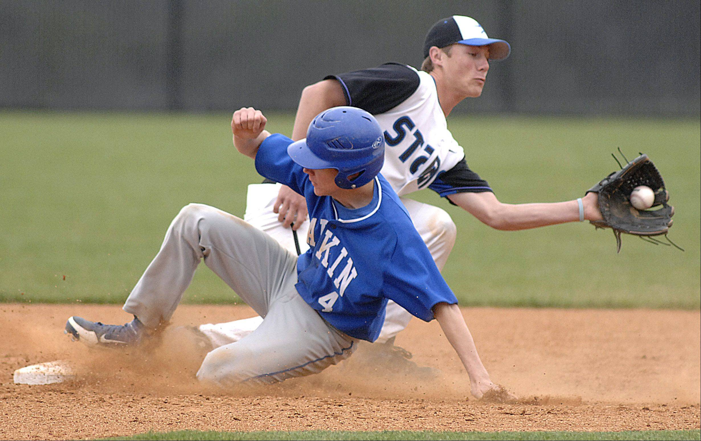 Larkin's Jack Eckholm is safe at second base as St. Charles North's Jake Johansmeier pulls in the throw Thursday in St. Charles.