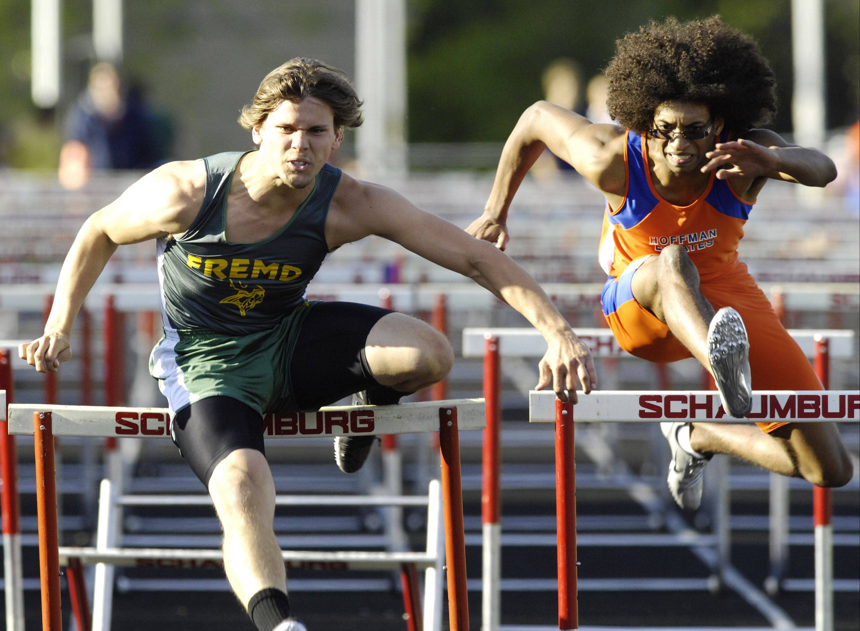 Fremd's Davy Mellado, left, and Hoffman Estates' James Vaughan run in the 110-meter high hurdles preliminaries during Tuesday's Mid-Suburban West boys track championships at Schaumburg.