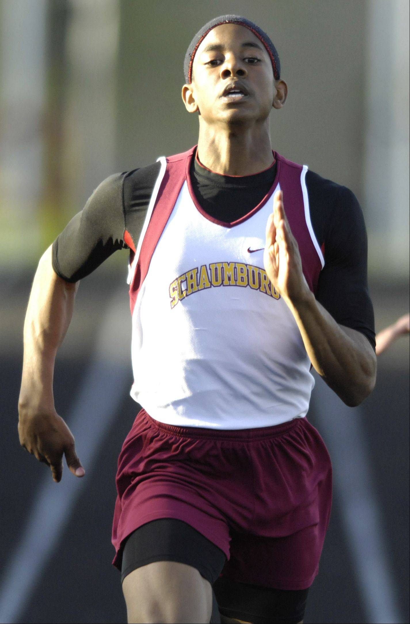 Schaumburg's Juwaan Richard wins the final qualifying heat of the 200-meter dash during Tuesday's Mid-Suburban West championships at Schaumburg.