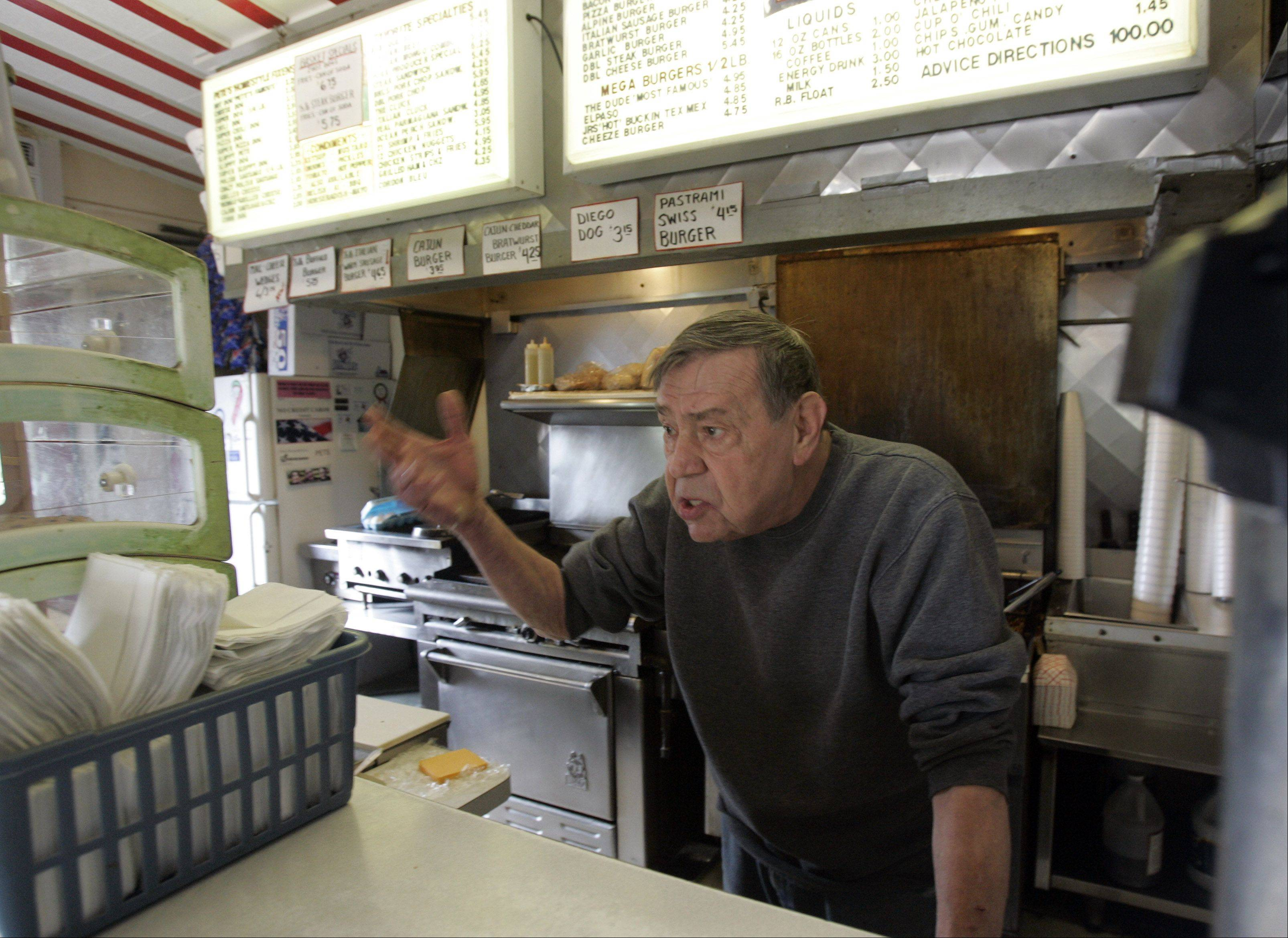 Peter Prevenas, owner of Pete's Famous Hot Dogs and Country Restaurant in Lily Lake, expresses his frustrations with the Illinois Department of Transportation and the changes that the construction at Routes 47 and 64 will cause for his business.