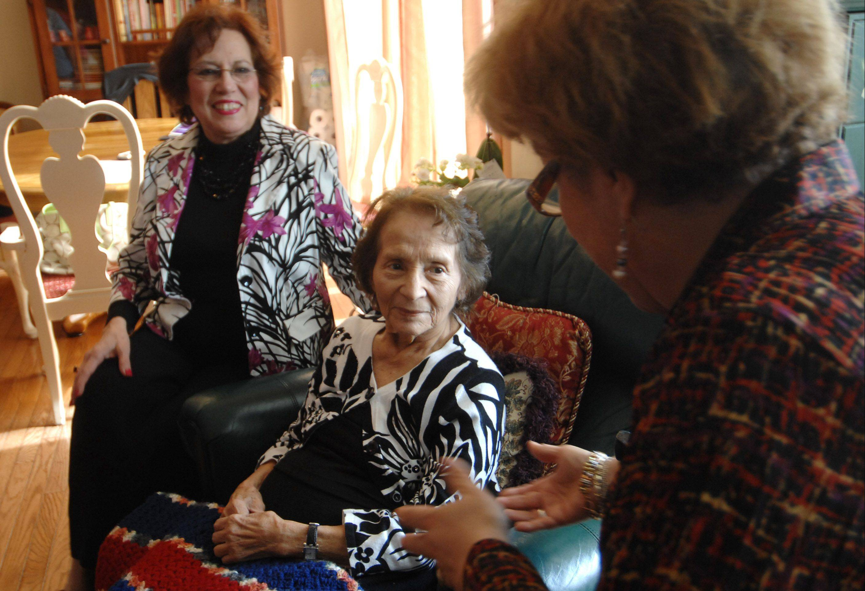 Maria Alvarez, 96, is a hospice patient in West Dundee. She is one of less than 6 percent of all hospice patients nationwide who are Latino. She is with her niece, also Maria, left, and granddaughter Maritza Ramirez.