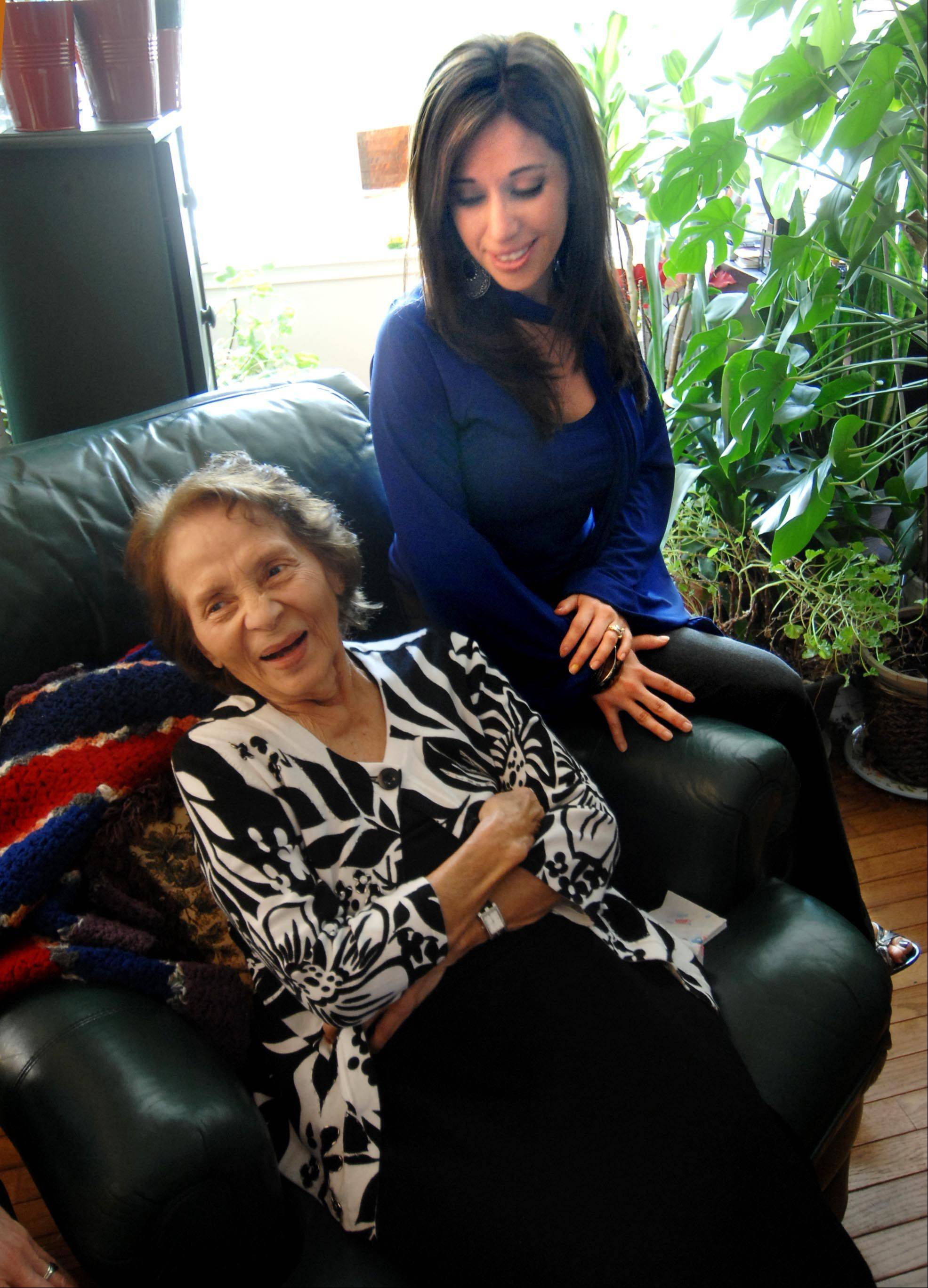 Maria Alvarez laughs with hospice community liaison Becky Bart in her West Dundee home. Maria is one of less than 6 percent of all hospice patients nationwide who are Latino.