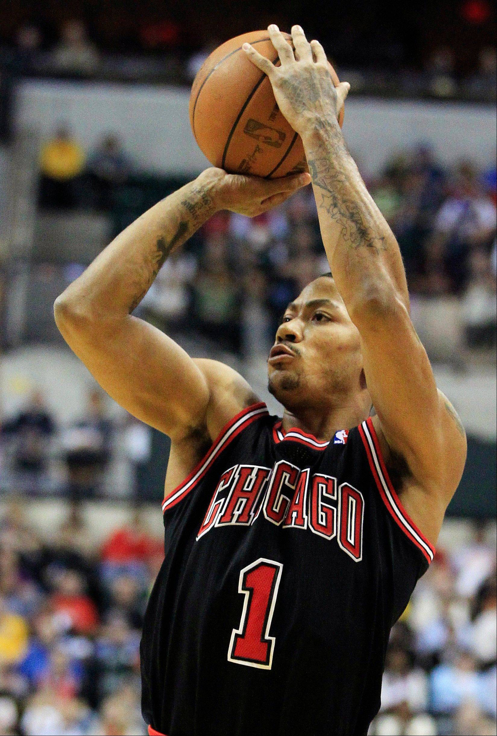 Bulls guard Derrick Rose shoots Wednesday during the first half against the Indiana Pacers.