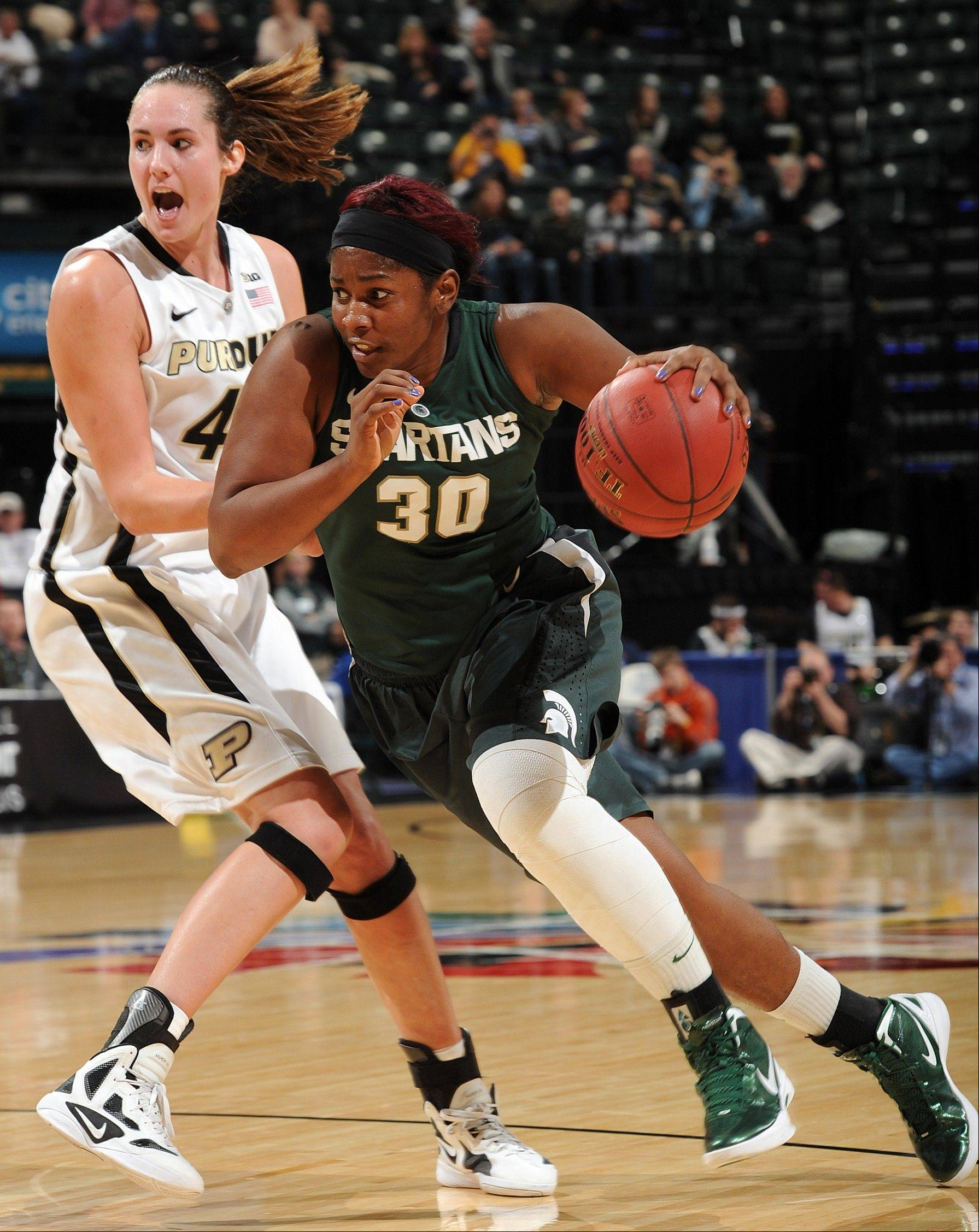 Michigan State's Lykendra Johnson drives against Purdue's Chelsea Jones in the 2012 Big 10 tournament. Johnson, an undrafted free agent, will have a tryout with the Chicago Sky.