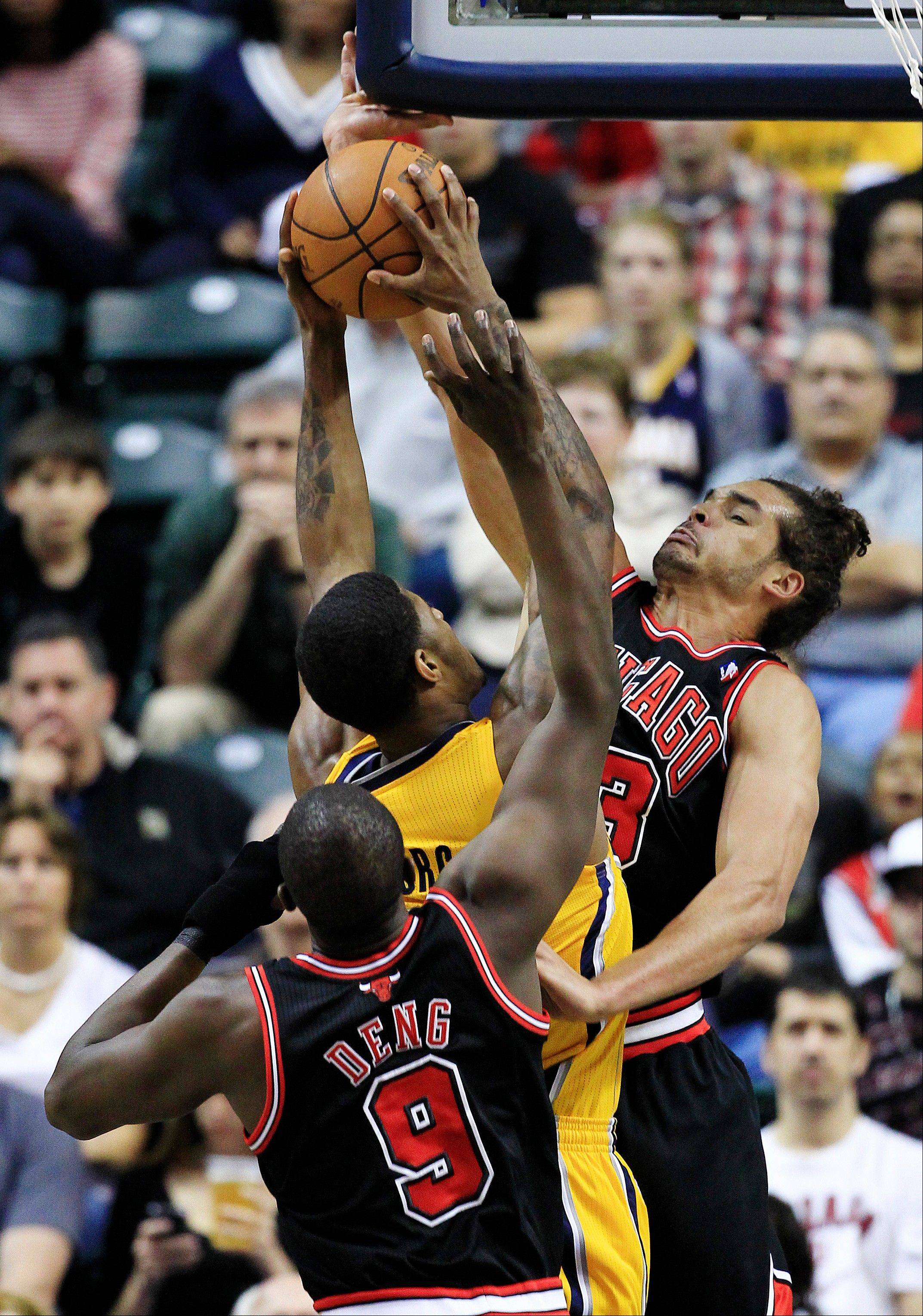 The Bulls' Luol Deng and Joakim Noah play some tight defense on the Pacers' Paul George during the first half Wednesday night.